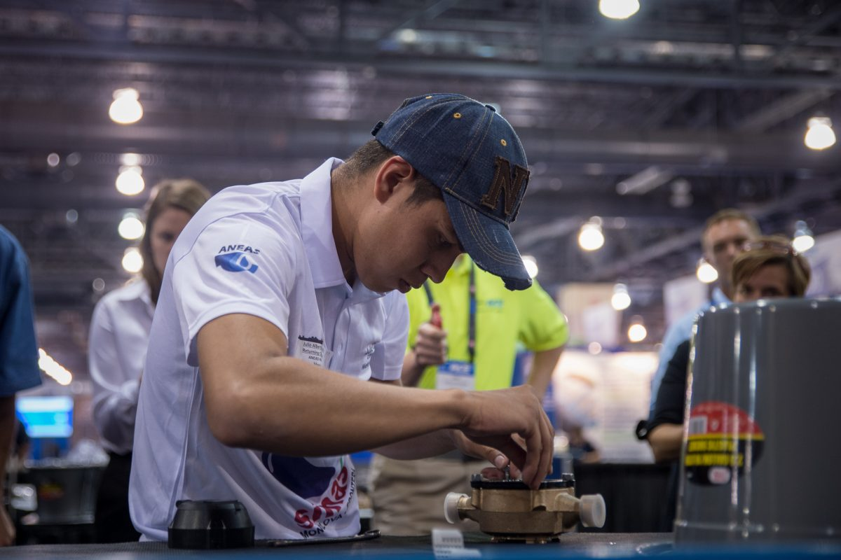 Julian Alberto Castillo races to reassemble a water meter from parts in the Meter Madness event at the American Water Works Association's annual conference at the Pennsylvania Convention Center. Castillo is the contest's defending champion.