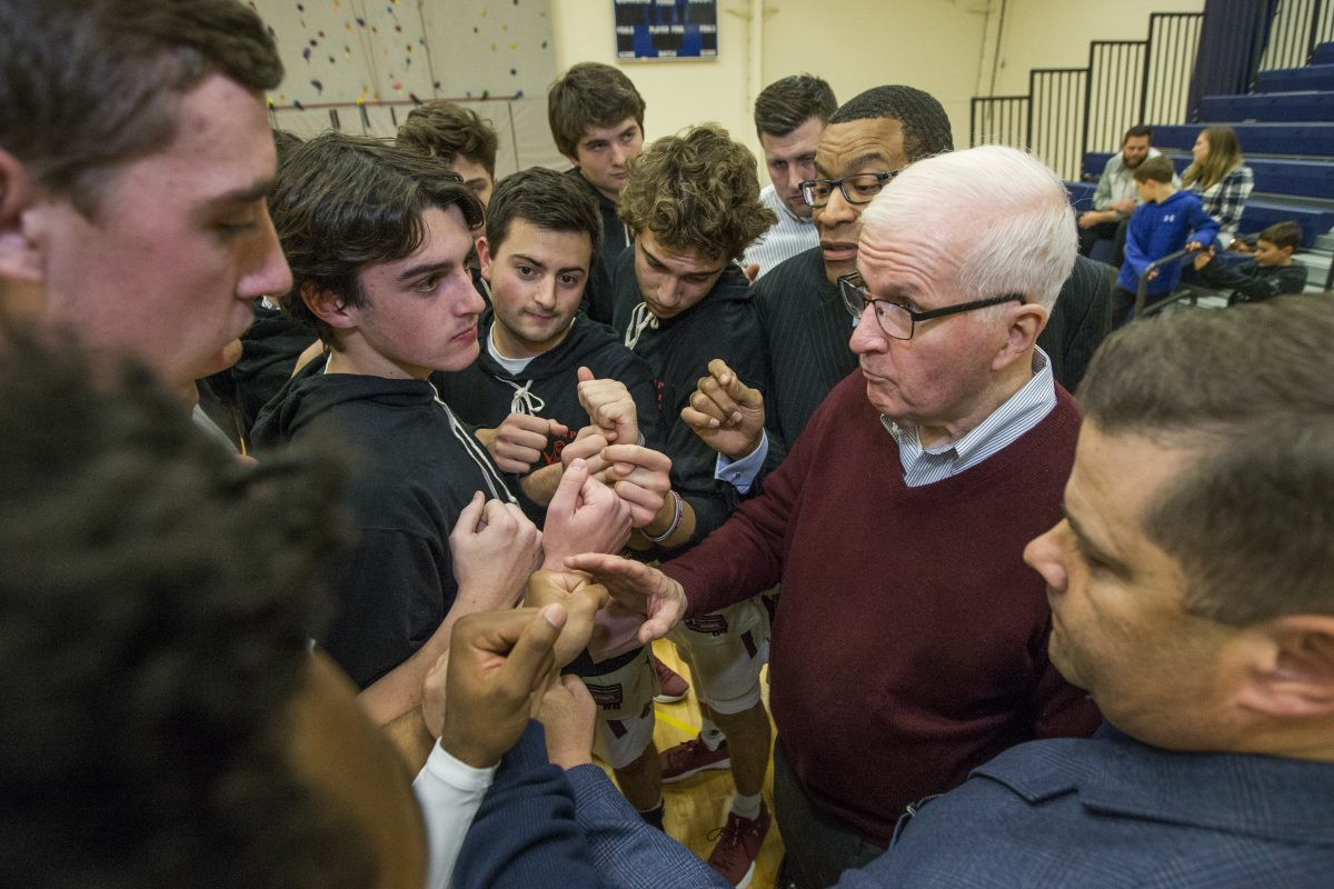 Speedy Morris gathers his St. Joseph's Prep team before a game.