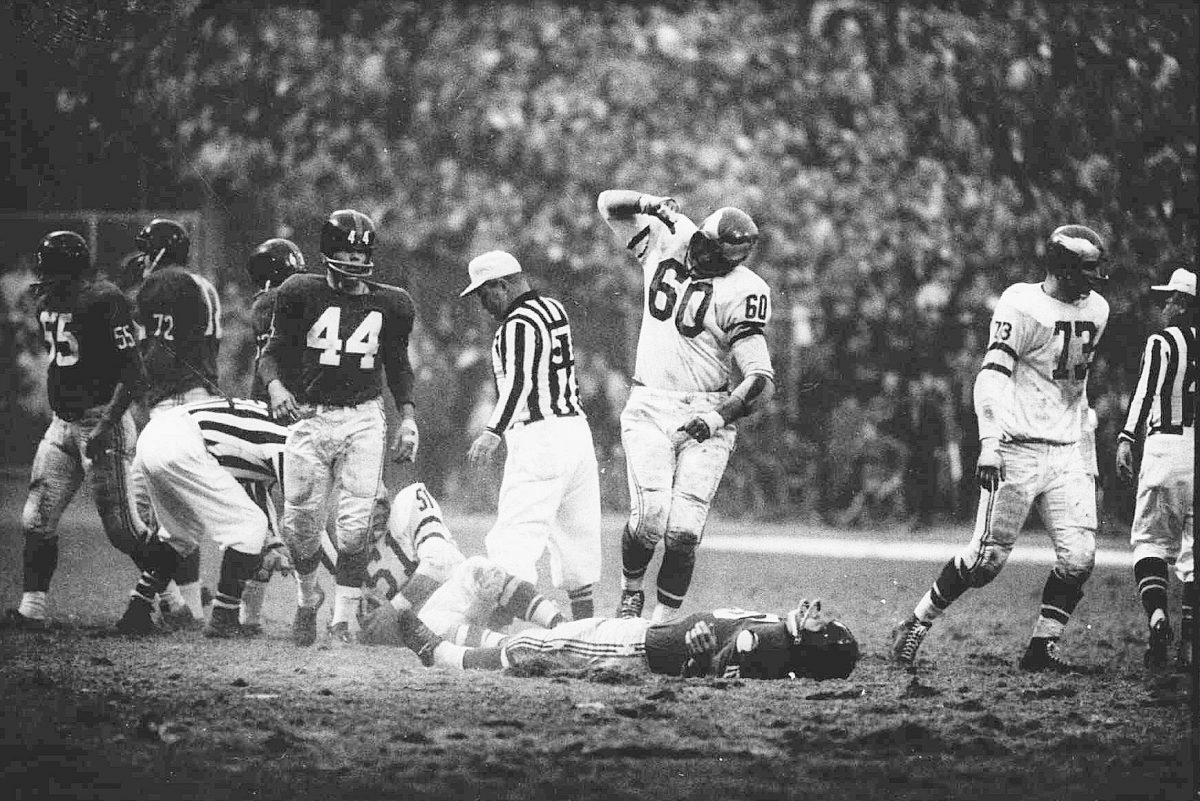This was the scene Nov. 20, 1960 as gesturing Eagles linebacker Chuck Bednarik (60) stood over unconscious Frank Gifford after making a hard tackle of the Giants halfback at Yankee Stadium. The impact caused Gifford to fumble, and sent him to a hospital. The ball was recovered by Chuck Weber (51), another Eagles linebacker.