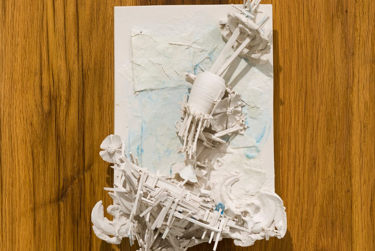 """Detail from Terri Saulin's porcelain sculpture, """"All is built on sand, but we must build as if the sand were stone"""" (2016), at Tiger Strikes Asteroid."""
