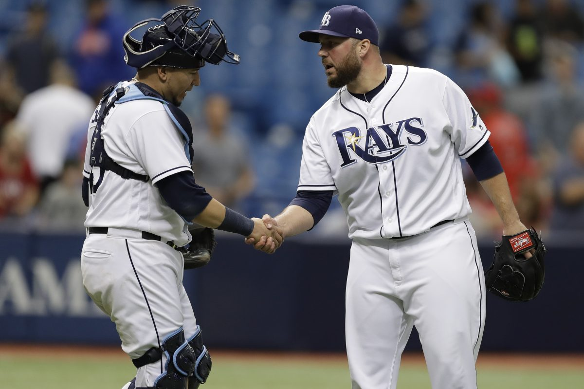 Tommy Hunter (right)  had a 2.61 ERA in 58 2/3 innings with the Tampa Bay Rays last season.