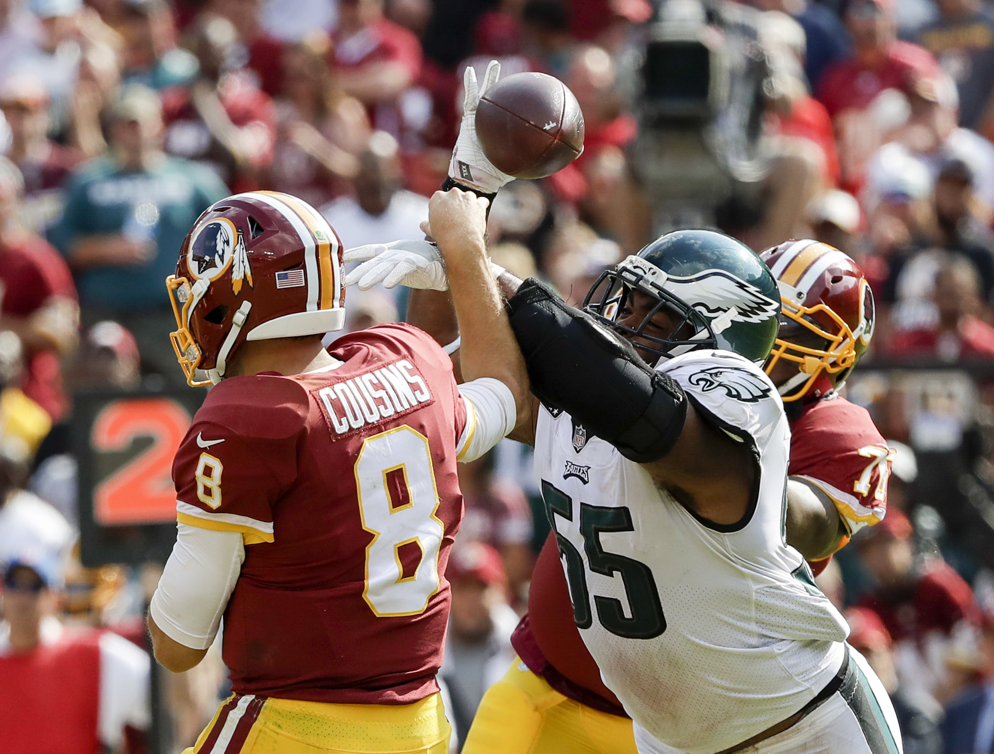Eagles defensive end Brandon Graham forces a fumble on Washington Redskins quarterback Kirk Cousins and past offensive tackle Morgan Moses during the fourth quarter in Week 1. Fletcher Cox recovered the fumble and scored a touchdown. YONG KIM / Staff Photographer