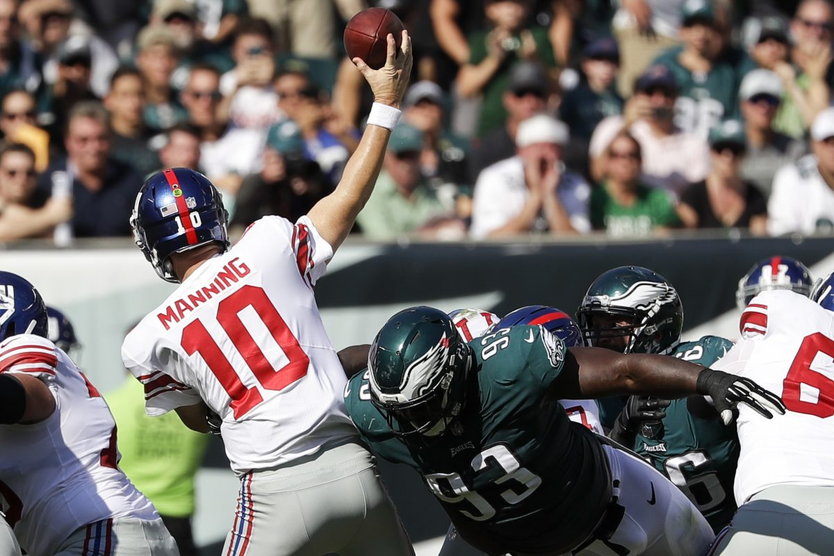 Eagles defensive tackle Tim Jernigan goes after Giants quarterback Eli Manning during the Eagles' heart-stopping, last-second win over the Giants in Week 3. YONG KIM / Staff Photographer