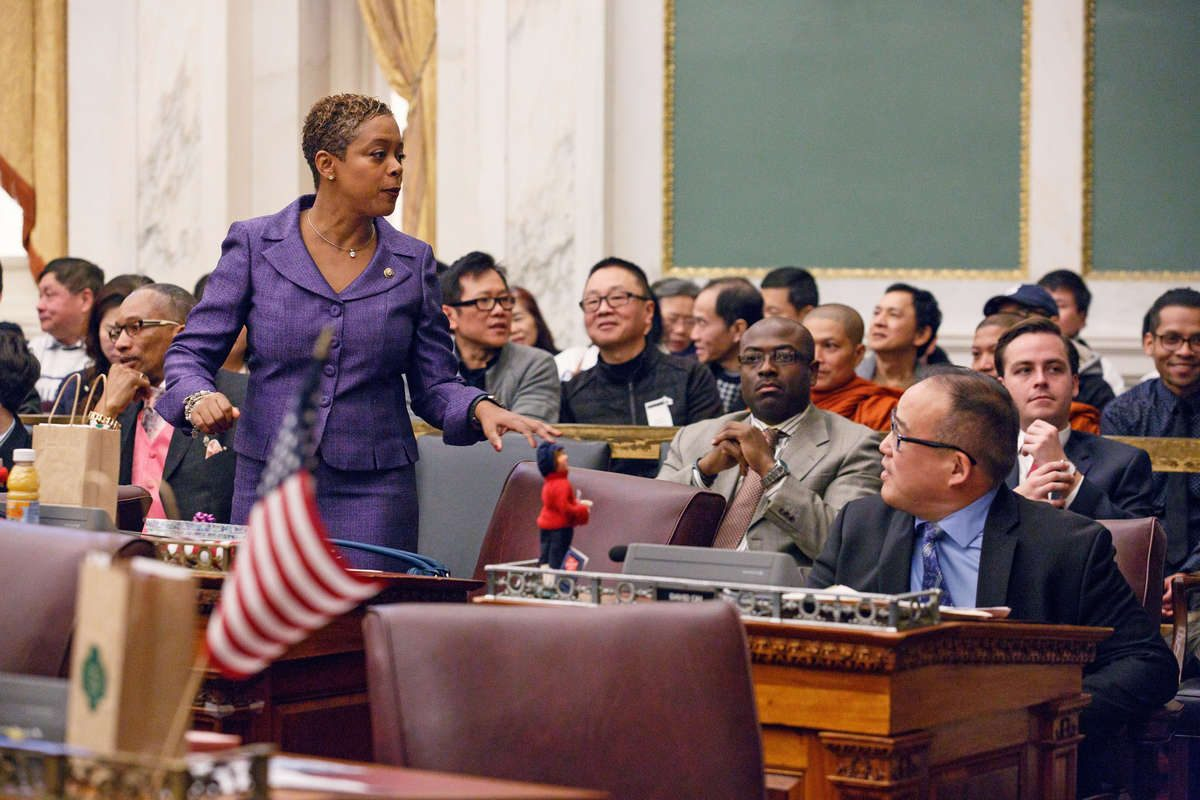City Councilwoman Cindy Bass (left) stands during Council's Dec. 14, 2017, session. Councilman David Oh is seen sitting (right). Adam Xu, chairman of the Asian American Licensed Beverage Association is seated in the gallery (wearing black coat). Photo taken before the hearing and vote on Bass' controversial bill that could eventually order the removal of bullet-resistant windows inside businesses like beer delis.