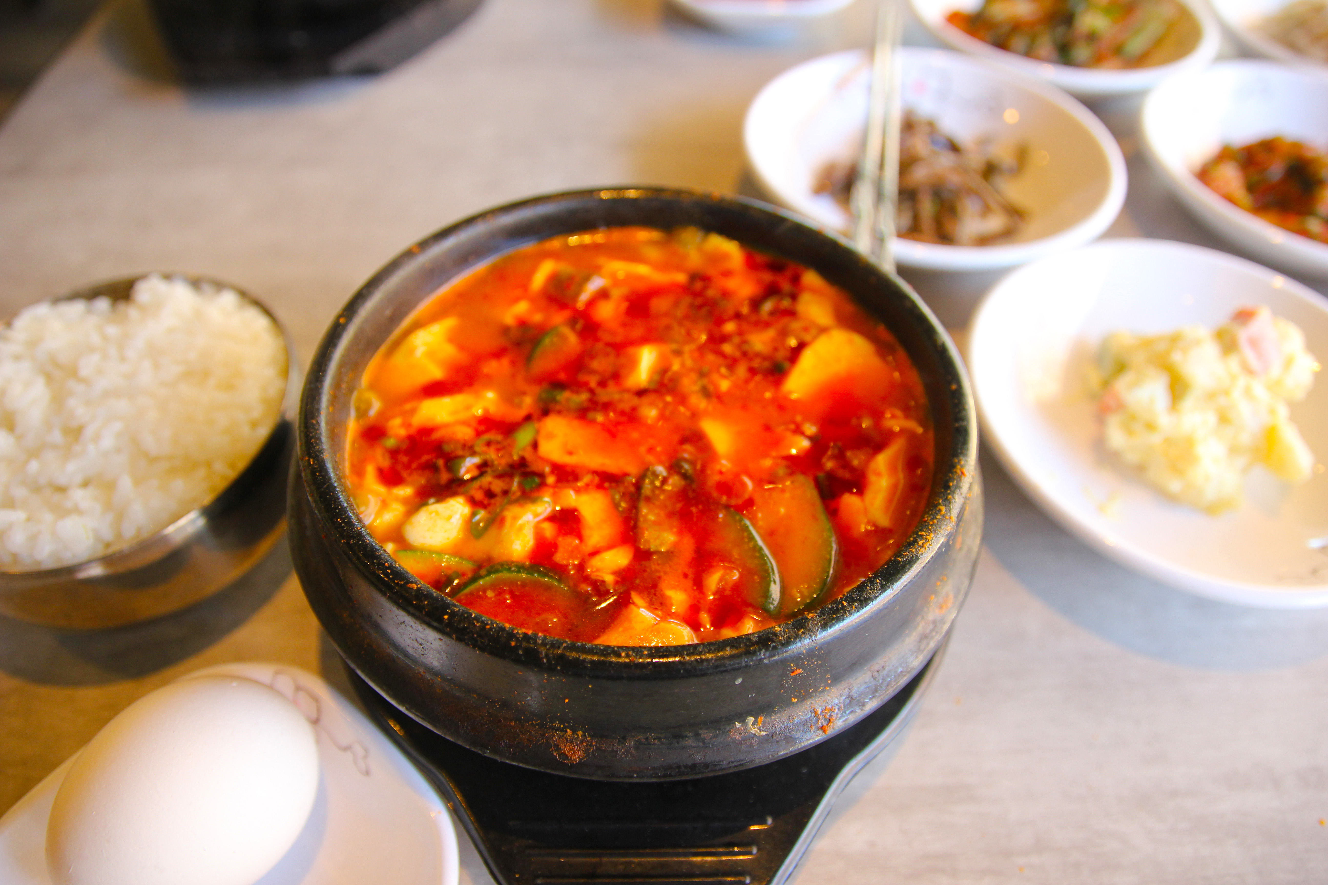 Jjigae and assorted banchan at Dae Bak, 1026 Race St., Second Floor.