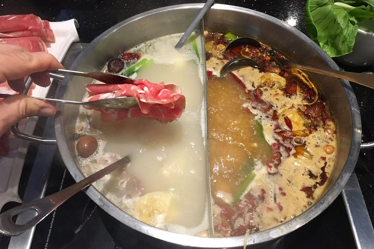 "The ""half and half"" style hot pot at Little Sheep Mongolian Hot Pot, 1019 Arch St."