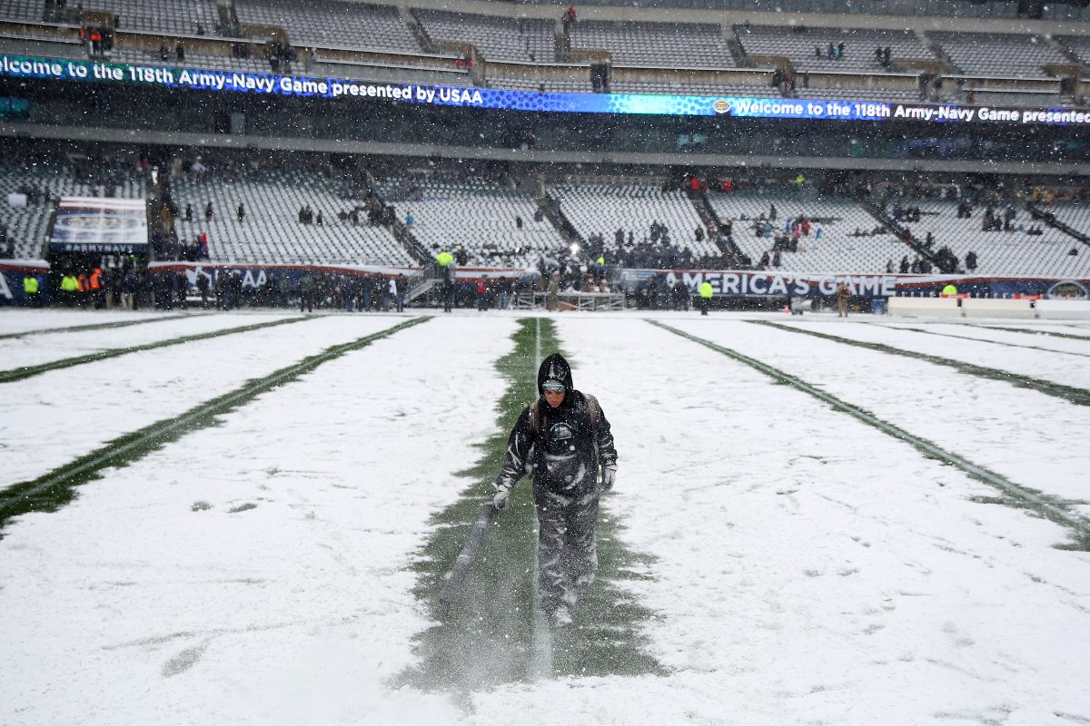 Early-season snow covered field for Army-Navy game Saturday.