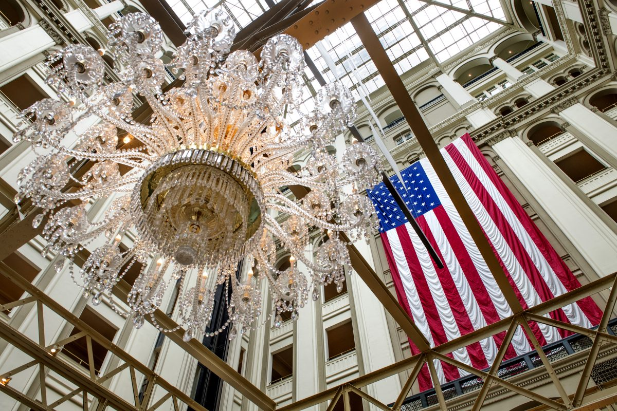 The chandelier and multistory U.S. flag in the lobby at the Trump International Hotel in Washington.