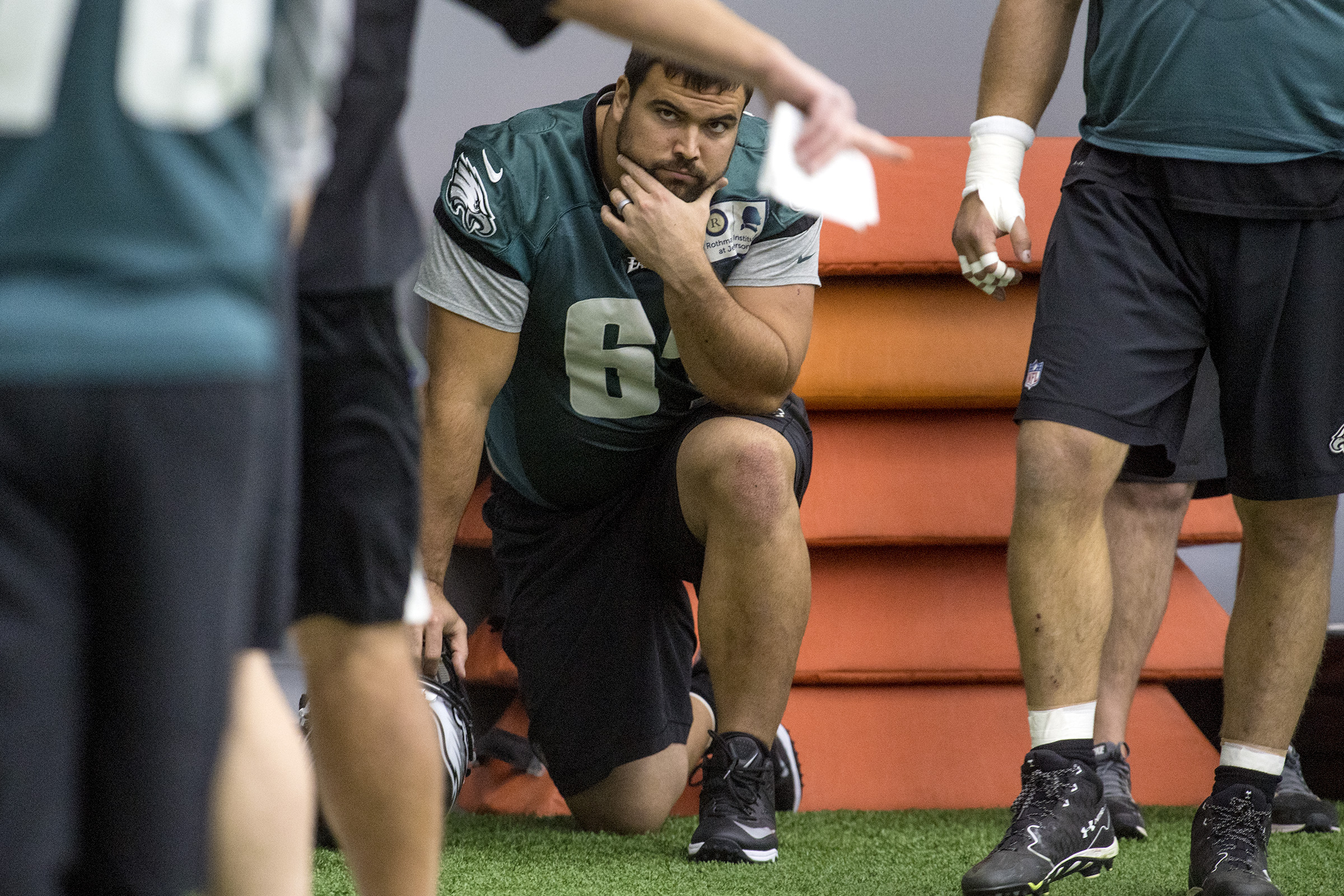 Injured Eagles offensive lineman Stefen Wisniewski listens as line coach Jeff Stoutland points something out during drills as the team prepares for their upcoming game against the New York Giants inside The Bubble at the Nova Care Complex December 13, 2017. CLEM MURRAY / Staff Photographer