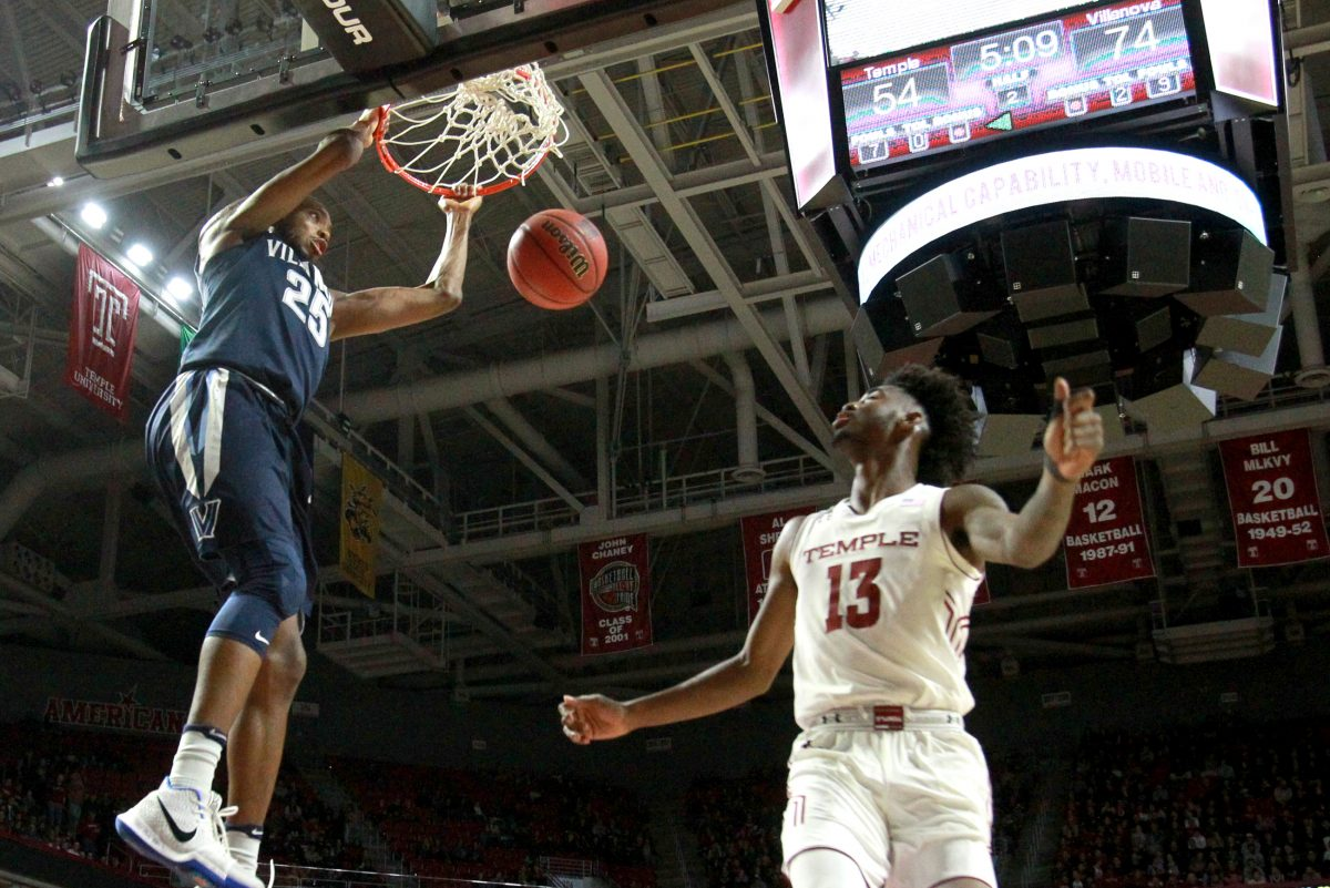 Mikal Bridges, left, of Villanova dunks in front of Quinton Rose of Temple at the Liacouras Center at Temple University on Dec. 13, 2017.
