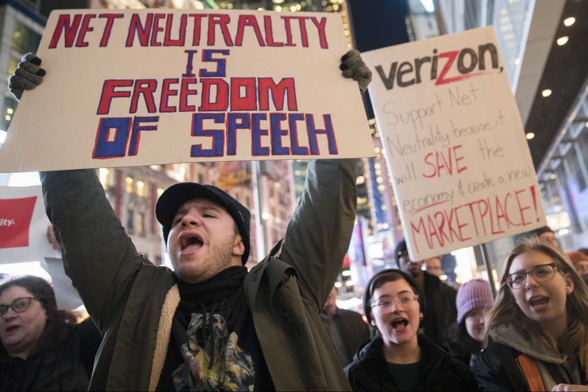 Demonstrators rally in support of net neutrality outside a Verizon store in New York on Dec. 7. The Federal Communications Commission voted today to scrap the net neutrality.