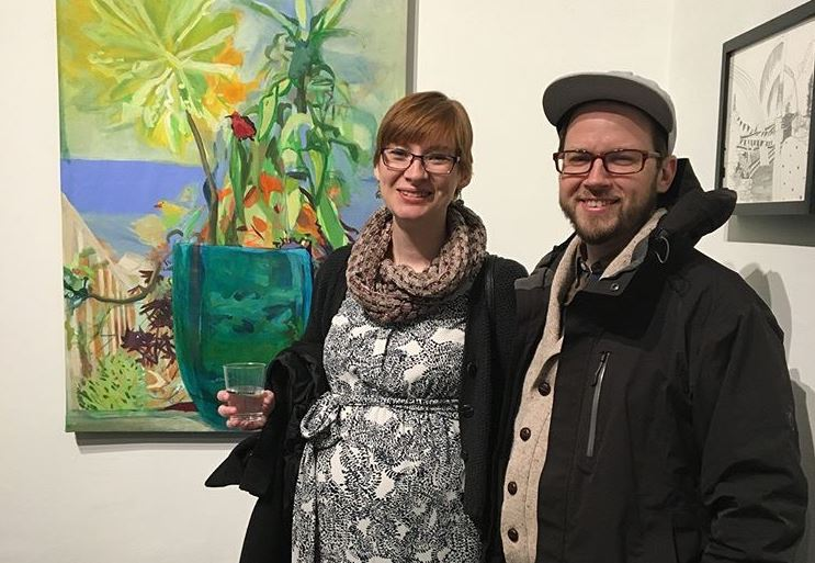Liz Hoffmann and Pat Woods at an art opening last week. The two planned their first date using AIM.