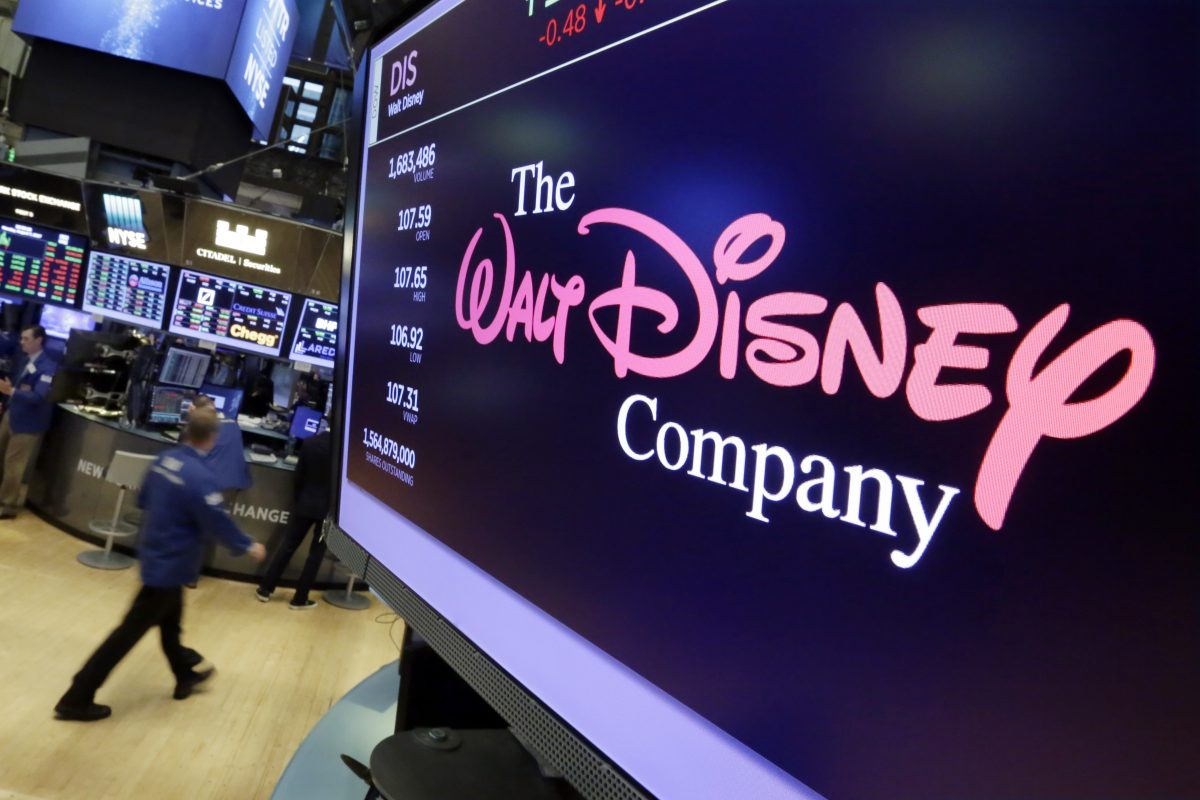 The Walt Disney Co. logo appears on a screen above the floor of the New York Stock Exchange. Disney is buying a large part of the Murdoch family´s 21st Century Fox in a $52.4 billion deal, announced  Dec. 14, including film and television studios, cable and international TV businesses as it tries to meet competition from technology companies in the entertainment business.