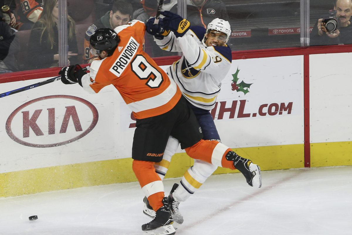 The Flyers´ Ivan Provorov checks the Sabres´ Evander Kane during the second period at the Wells Fargo Center.