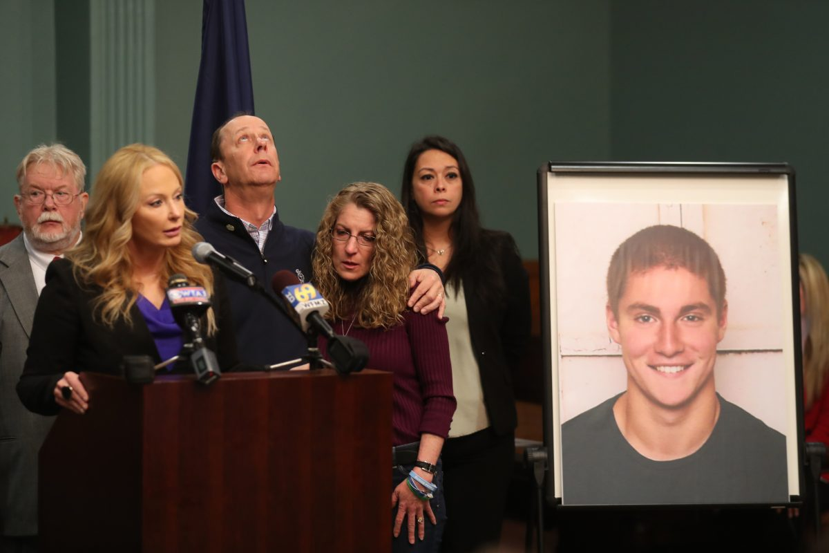 Centre County DA Stacy Parks Miller speaks about the Beta Theta Pi hazing investigation and the charges brought against 18 people last spring. Timothy Piazza´a parents Jim and Evelyn Piazza stand with her in the Centre County Court annex in Bellefonte, Pa., Friday May 5, 2017. ( DAVID SWANSON / Staff Photographer )