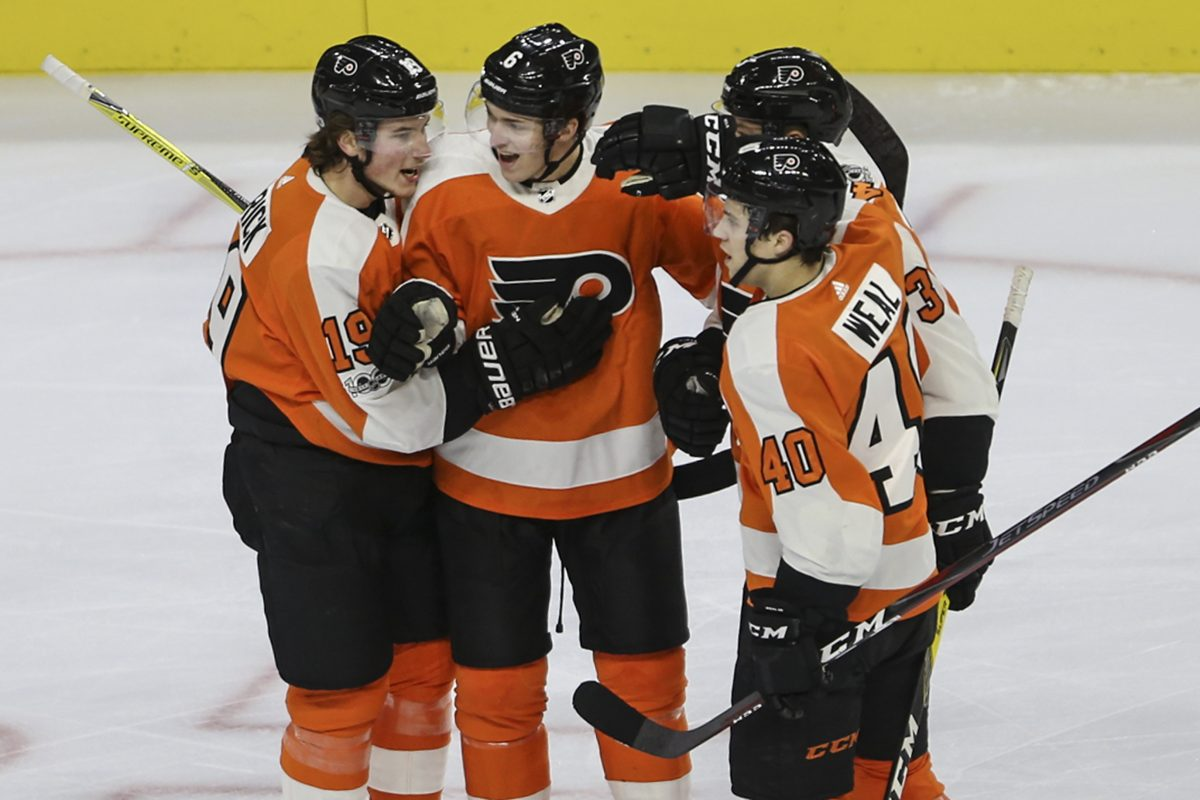 Flyers´ Travis Sanheim, center celebrates with teammates his first NHL goal, against the Sabres during the first period at the Wells Fargo Center in Philadelphia, Thursday, December 14, 2017. STEVEN M. FALK / Staff Photographer