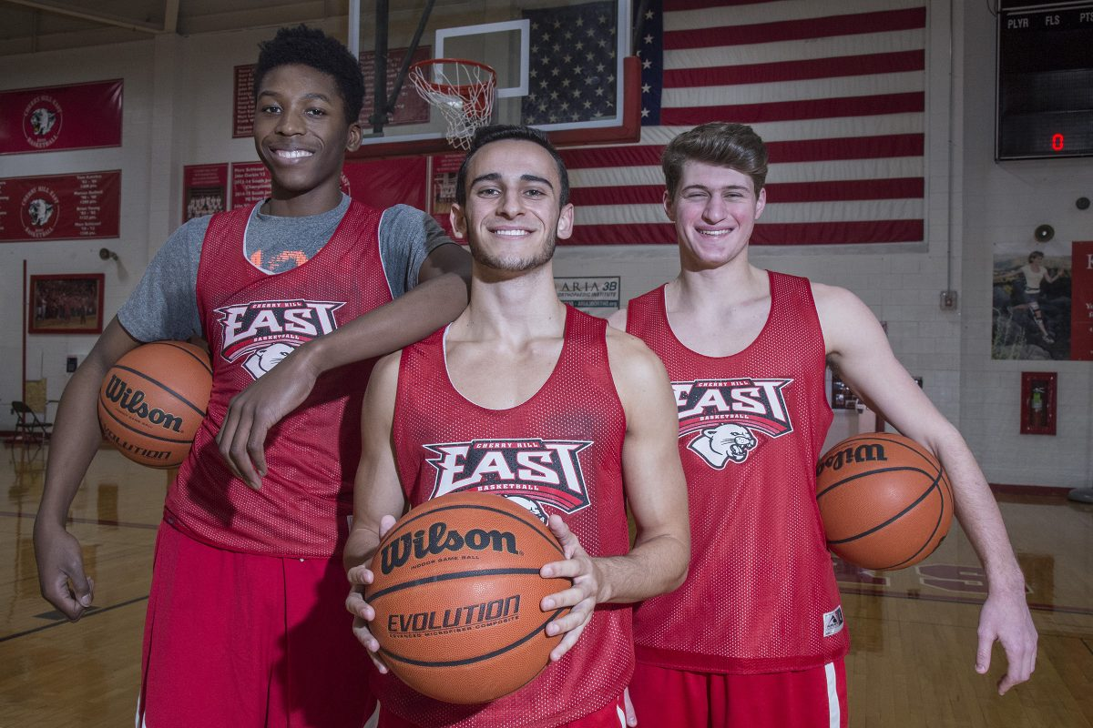 Cherry Hill East senior basketball players (from left) Dienye Peterside, Jared Ohnona and Jake Berstein all were cut from middle school team but have developed into key players for varsity.