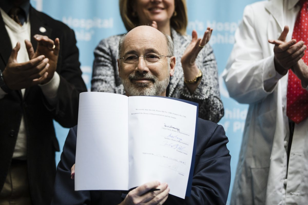 Pennsylvania Gov. Tom Wolf shows his signature after he signed legislation reauthorizing Pennsylvania´s Children´s Health Insurance Program at Children´s Hospital of Philadelphia on Friday.