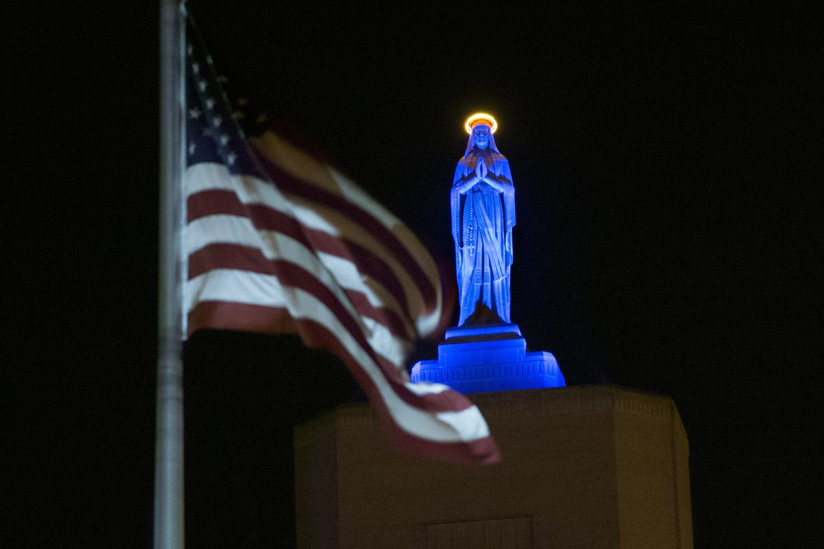 Cooper University Health Care has decided not to pursue the acquisition of Lourdes Health System and St. Francis Medical Center. Show here is the the Virgin Mary statue atop Our Lady of Lourdes Medical Center in Camden lighted blue November 3, 2016, in honor of the Chicago Cubs'  World Series victory.