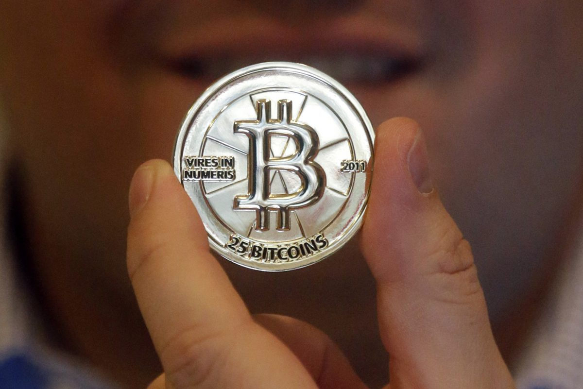 FILE -Bitcoin doesn't exist in the physical world. If it did, bitcoin might look like this mockup. (AP Photo/Rick Bowmer, File)