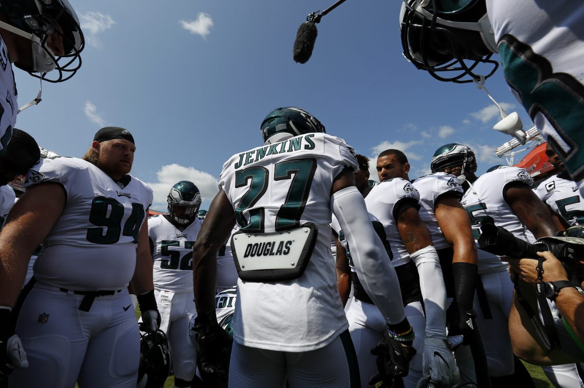 Philadelphia Eagles strong safety Malcolm Jenkins (27) leads teammates in a huddle before an NFL football game against the Washington Redskins, Sunday, Sept. 10, 2017, in Landover, Md.
