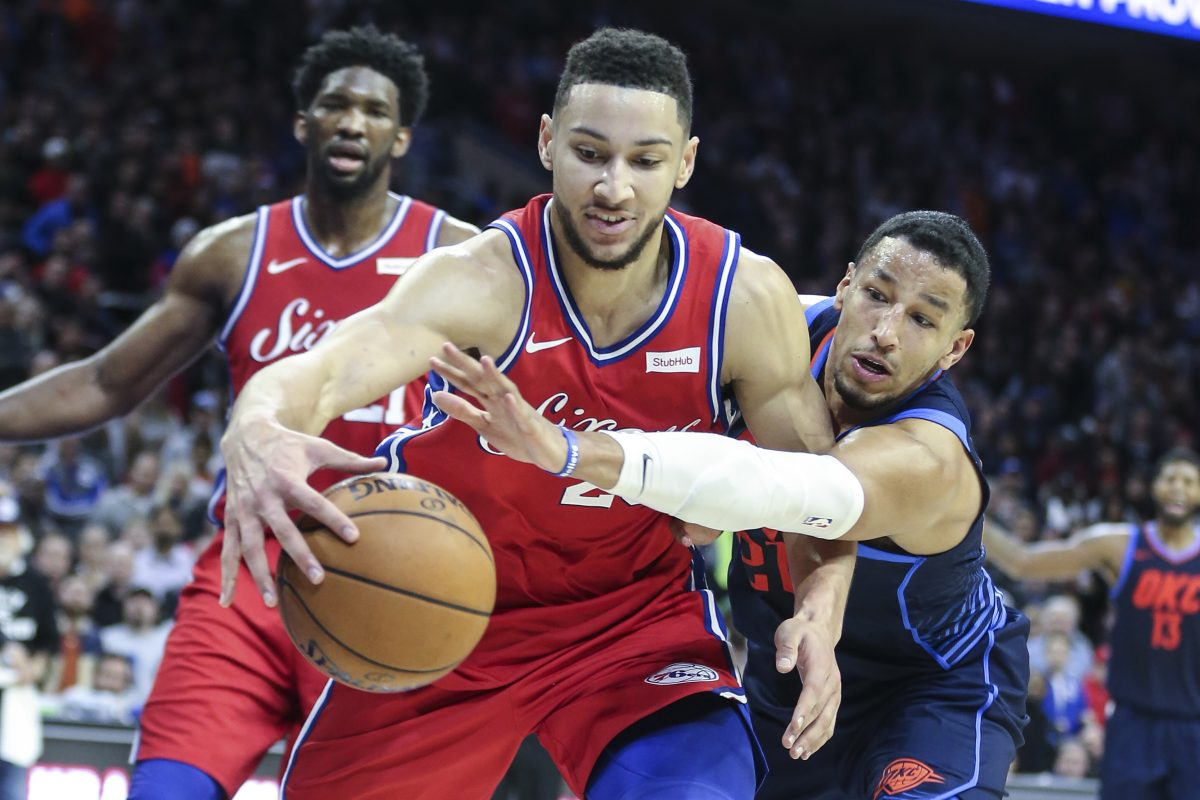 Sixers' point guard Ben Simmons fights for a rebound against Thunder guard Andre Roberson on Friday.
