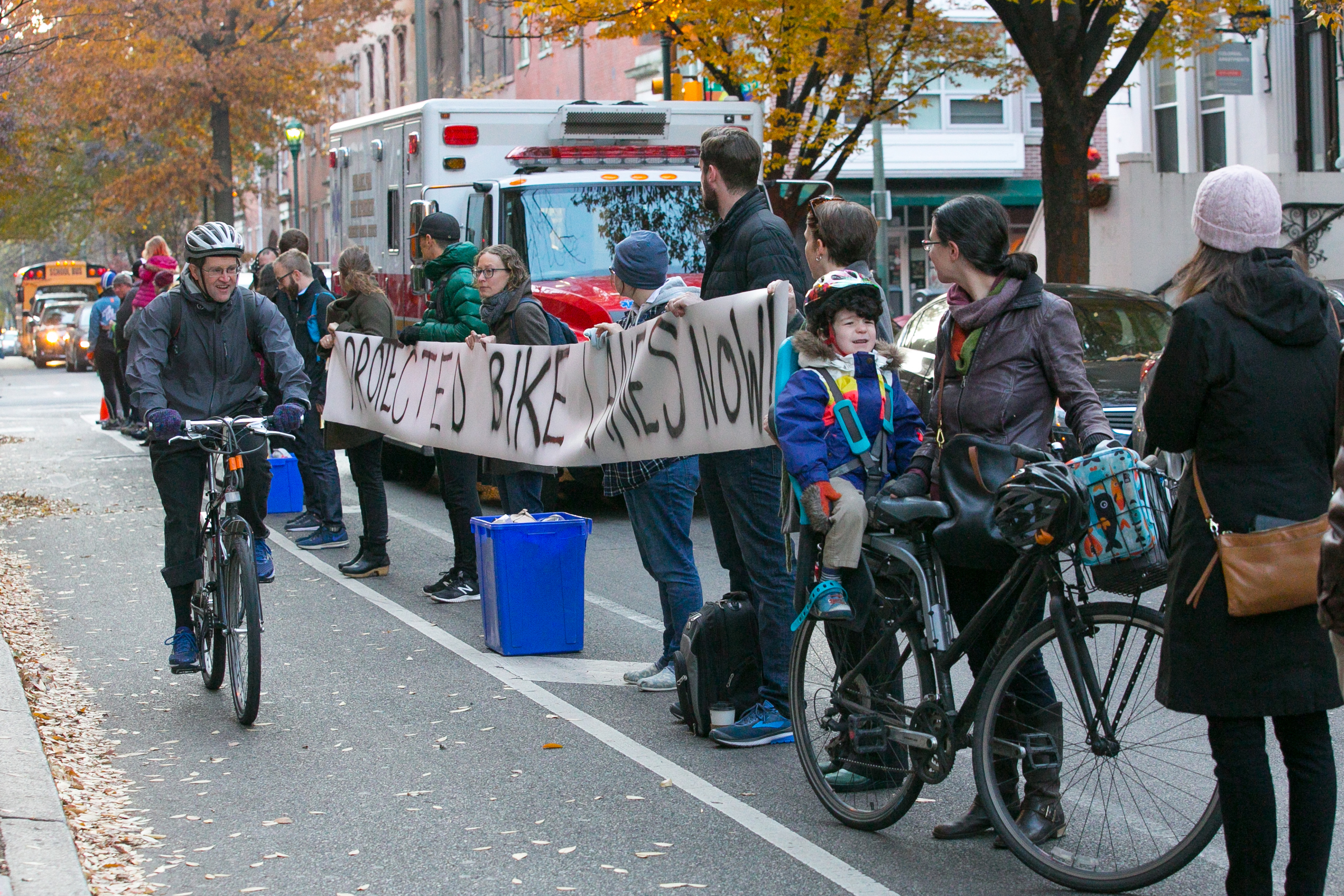 Protestors advocate for safer bike lanes by lining up at 11th and Spruce Streets, in Philadelphia, Wednesday, Nov. 29, 2017.