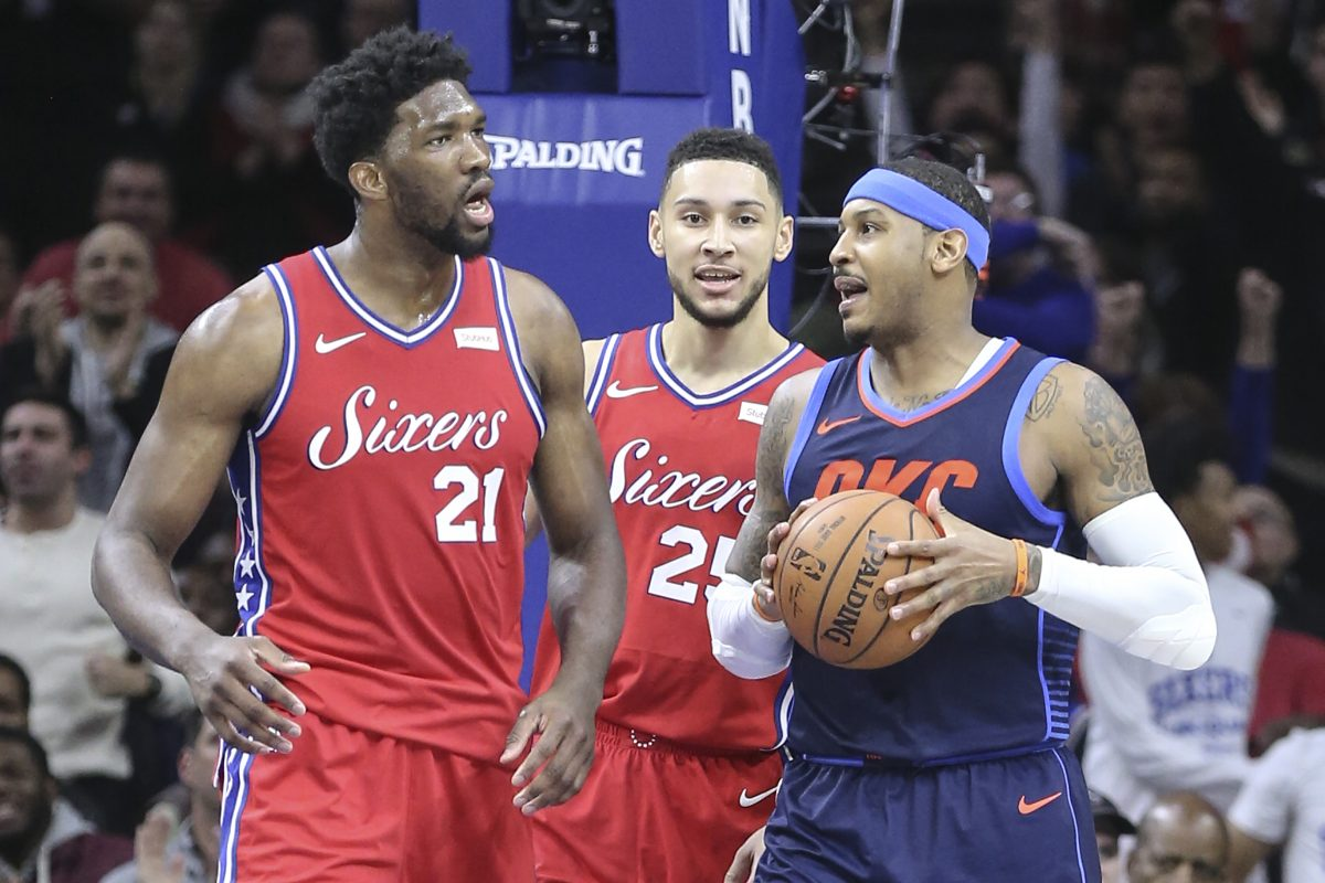 Sixers center Joel Embiid (left) has words with Thunder forward Carmelo Anthony (center) with Ben Simmons in the middle during the third quarter of the Sixers' triple-overtime loss to the Thunder.