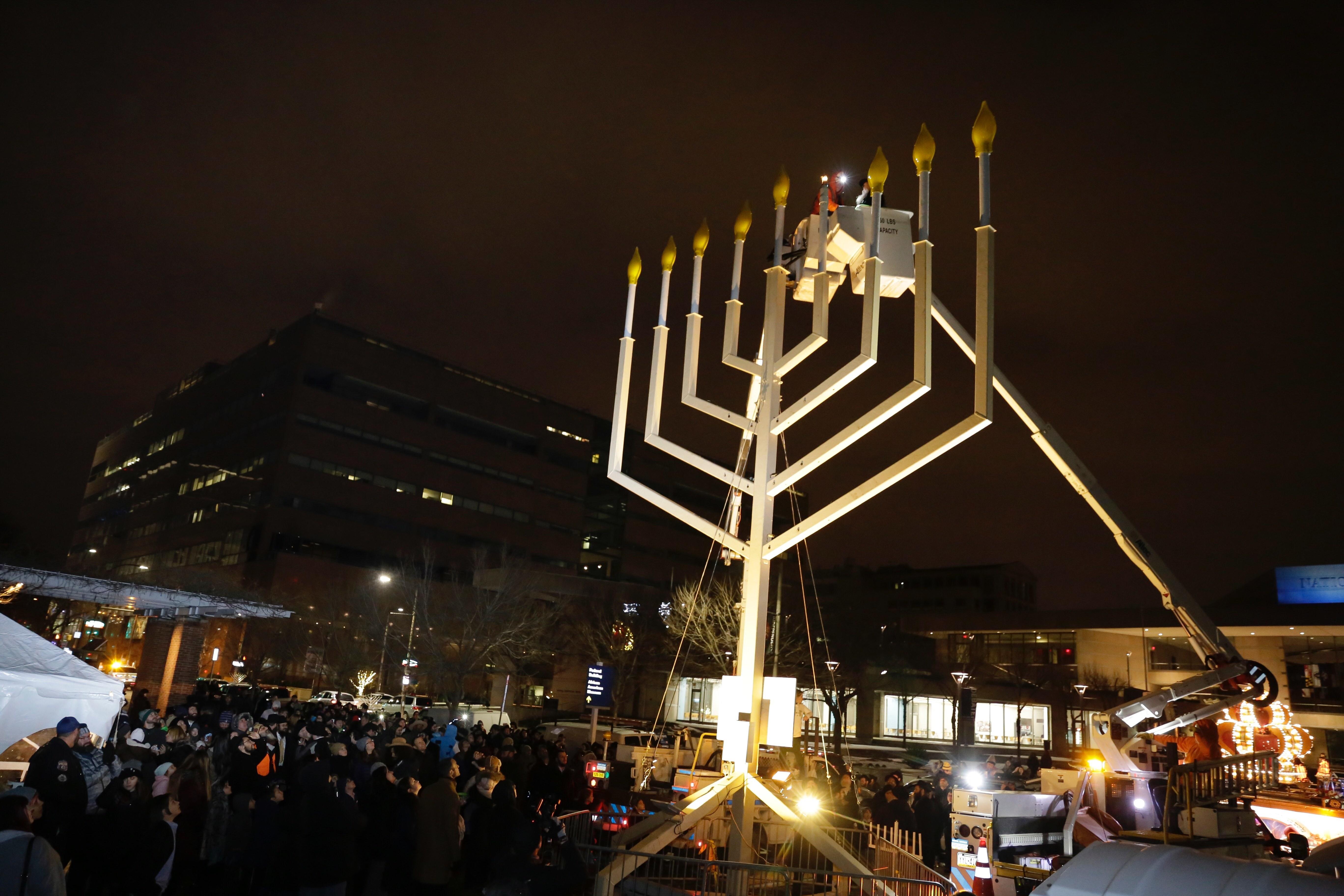 Chabad-Lubavitch Rabbi Abraham Shemtov prepares for the lighting of the Hanukkah menorah at Independence National Park.