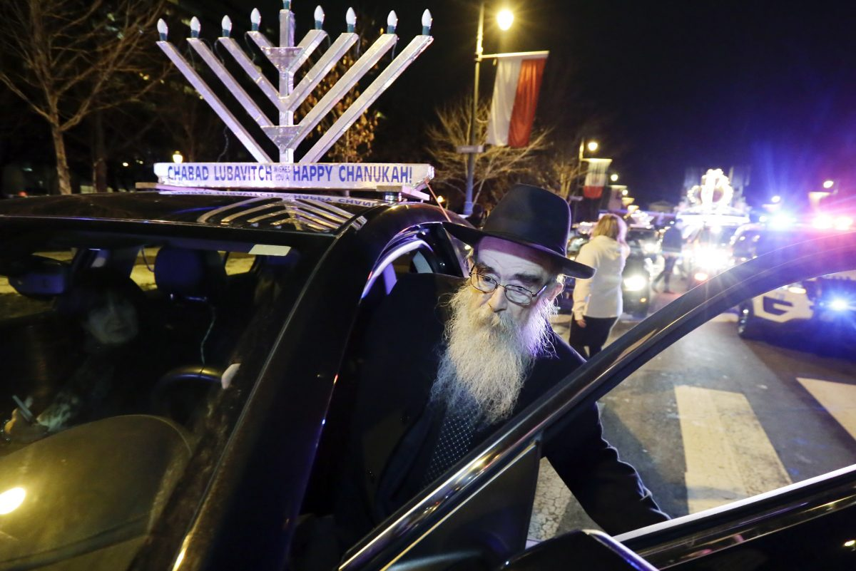 Rabbi Abraham Shemtov leads a parade of menorah-topped cars from Benjamin Franklin Parkway to Independence National Park. The event was held to celebrate the fifth night of Hanukkah.