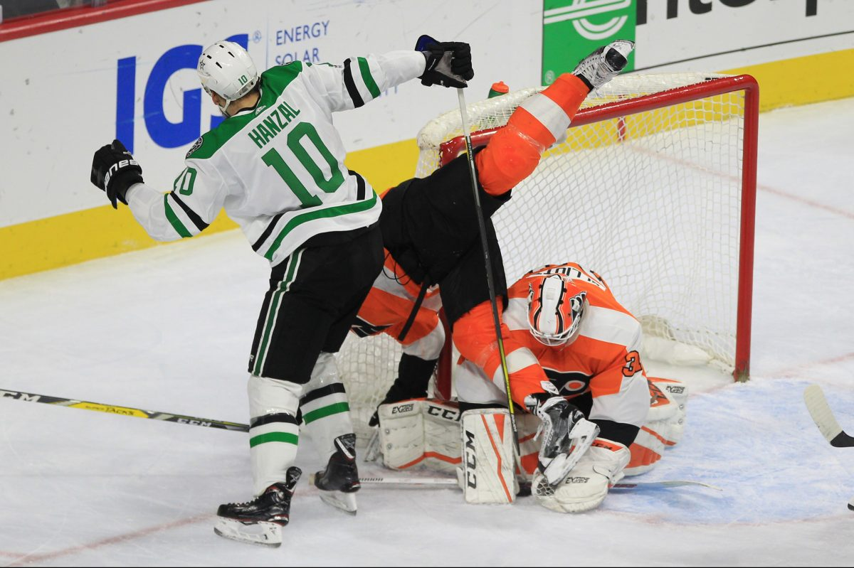 Martin Hanzal, left, of the Stars and Radko Gudas, center, of the Flyers get tangeled up in front of Flyers goalie Brian Elliott in the 2nd period at the Wells Fargo Center on Dec. 16, 2017.