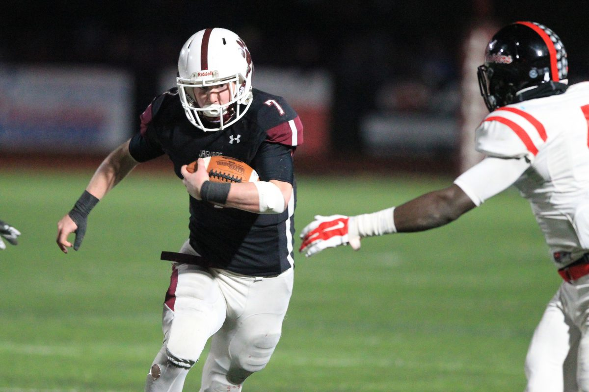 Garnet Valley's Danny Guy (7) runs for a long gain against Coatesville in the PIAA District 1 Class 6A championship game.