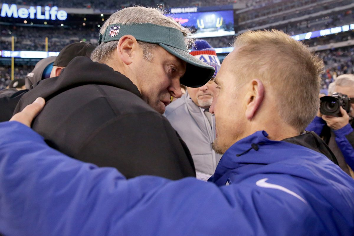 Eagles head coach Doug Pederson, left, and Giants interim head coach Steve Spagnuolo, right, meet on the field after the Philadelphia Eagles win 34-29 over the New York Giants in East Rutherford, New Jersey on December 17, 2017.