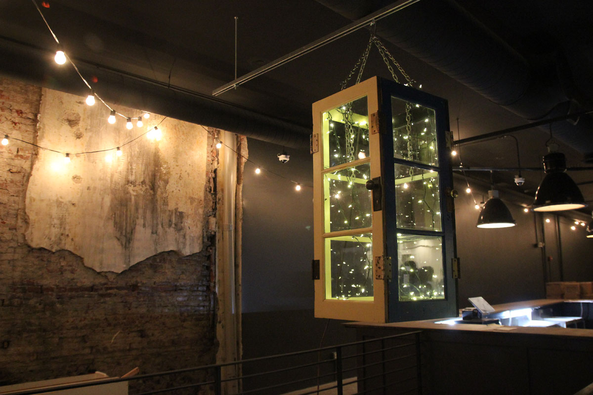 A chandelier made of old, wood-framed doors at Porta, 1214-16 Chestnut St.
