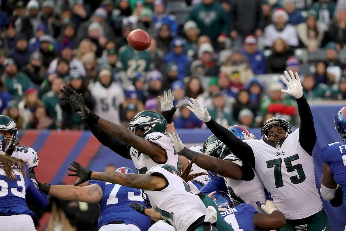 Eagles' Malcolm Jenkins, center, blocks a Giants' field goal attempt in the 4th quarter. Philadelphia Eagles win 34-29 over the New York Giants in East Rutherford, New Jersey on December 17, 2017. DAVID MAIALETTI / Staff Photographer