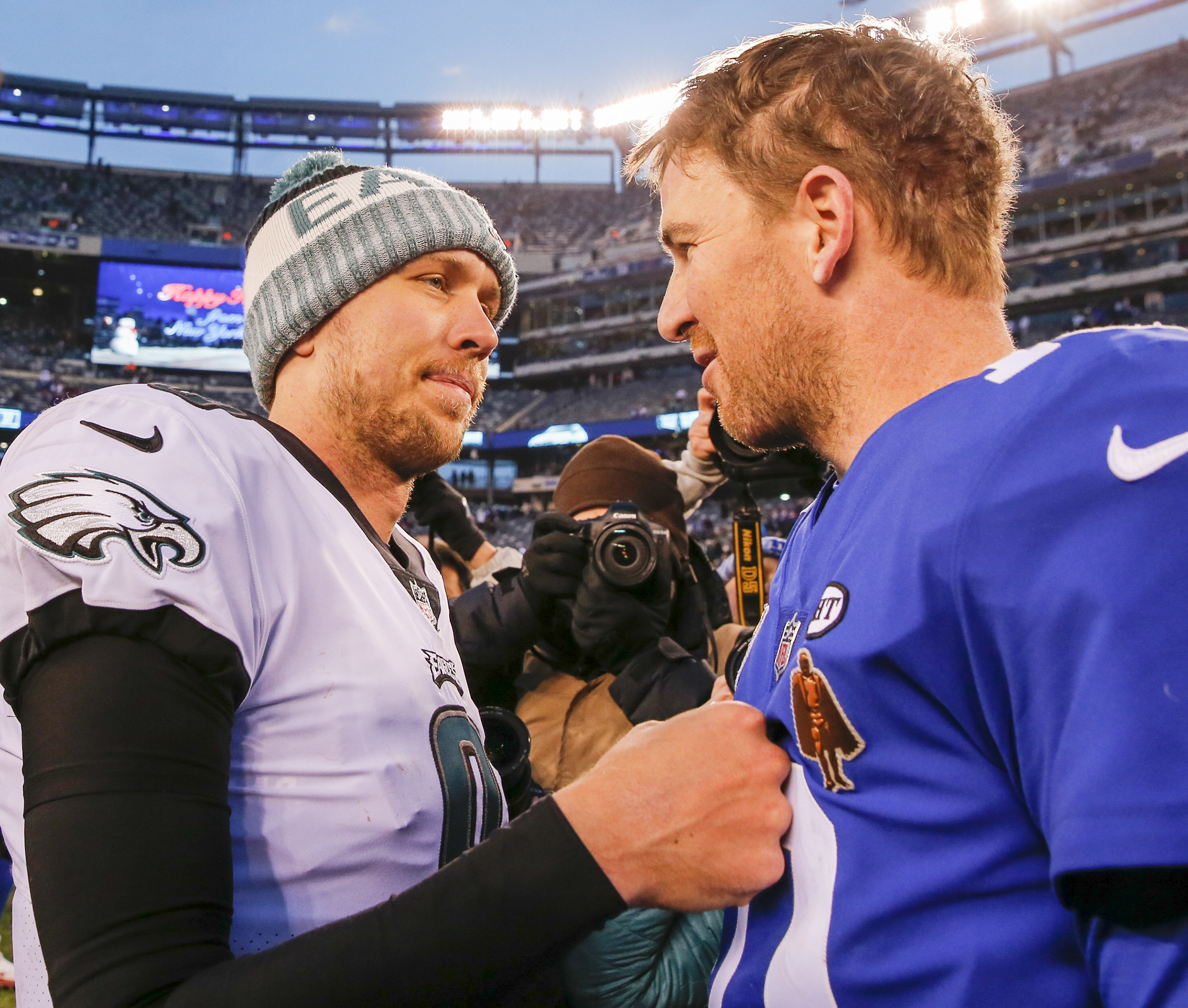 Eagles quarterback Nick Foles meets with Giants quarterback Eli Manning (right) after the Eagles beat the Giants.