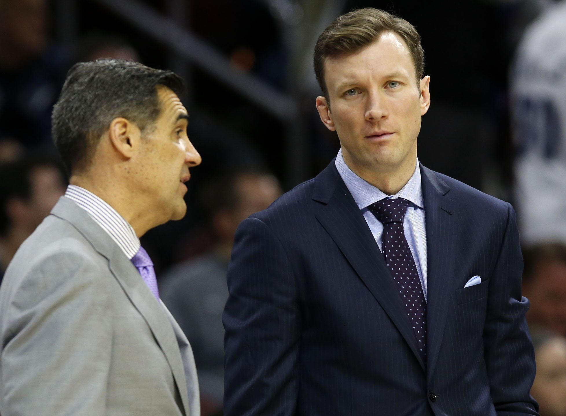 Baker Dunleavy, then Villanova associate head coach, talking to head coach Jay Wright during a January game against Providence.