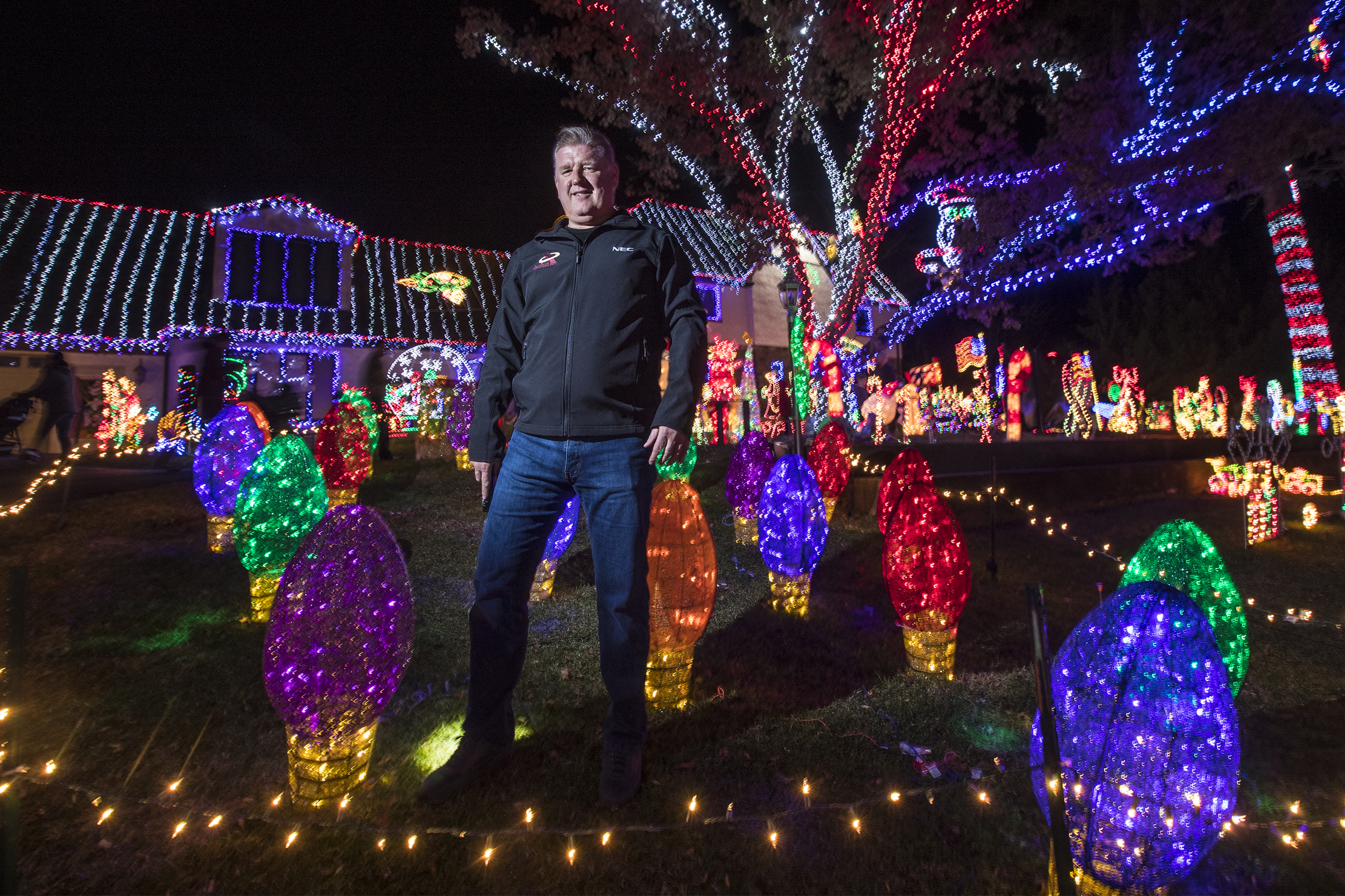 "Jack Yoast, of Ambler, PA , stands in the ""Bulb Garden"" of his front yard Christmas Extravaganza that he creates every year for ten years to the delight of hundreds of people that come and walk through it every night. He doesn't charge admission but asks for donations for a local charity. MICHAEL BRYANT/ Staff Photographer"