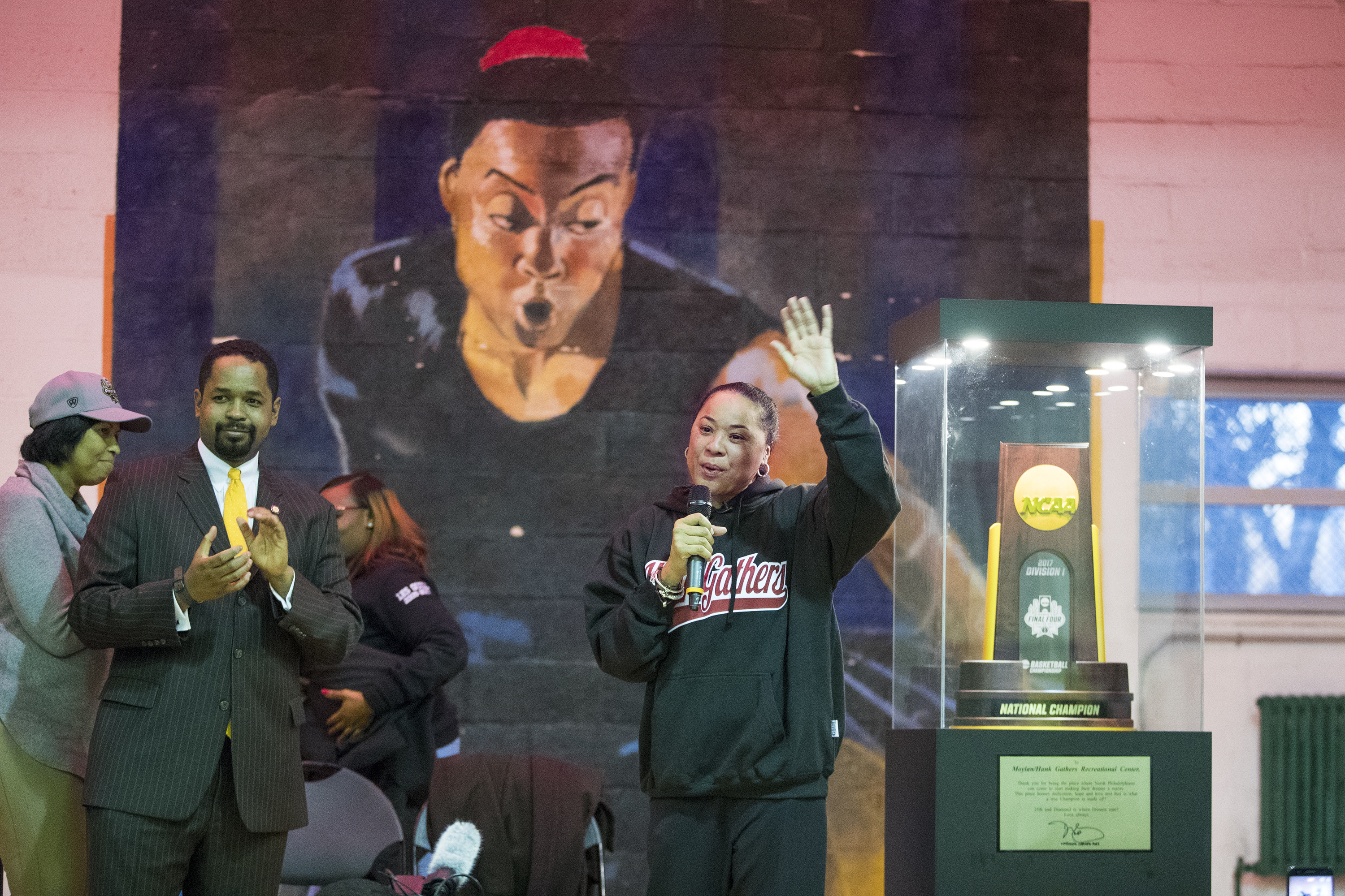 Dawn Staley waves to the crowd after a replica of the NCAA National Championship trophy was donated to the Hank Gathers Recreation Center on Dec. 20, 2017. Her national chmpionship South Carolina team will play Temple tomorrow. CHARLES FOX / Staff Photographer