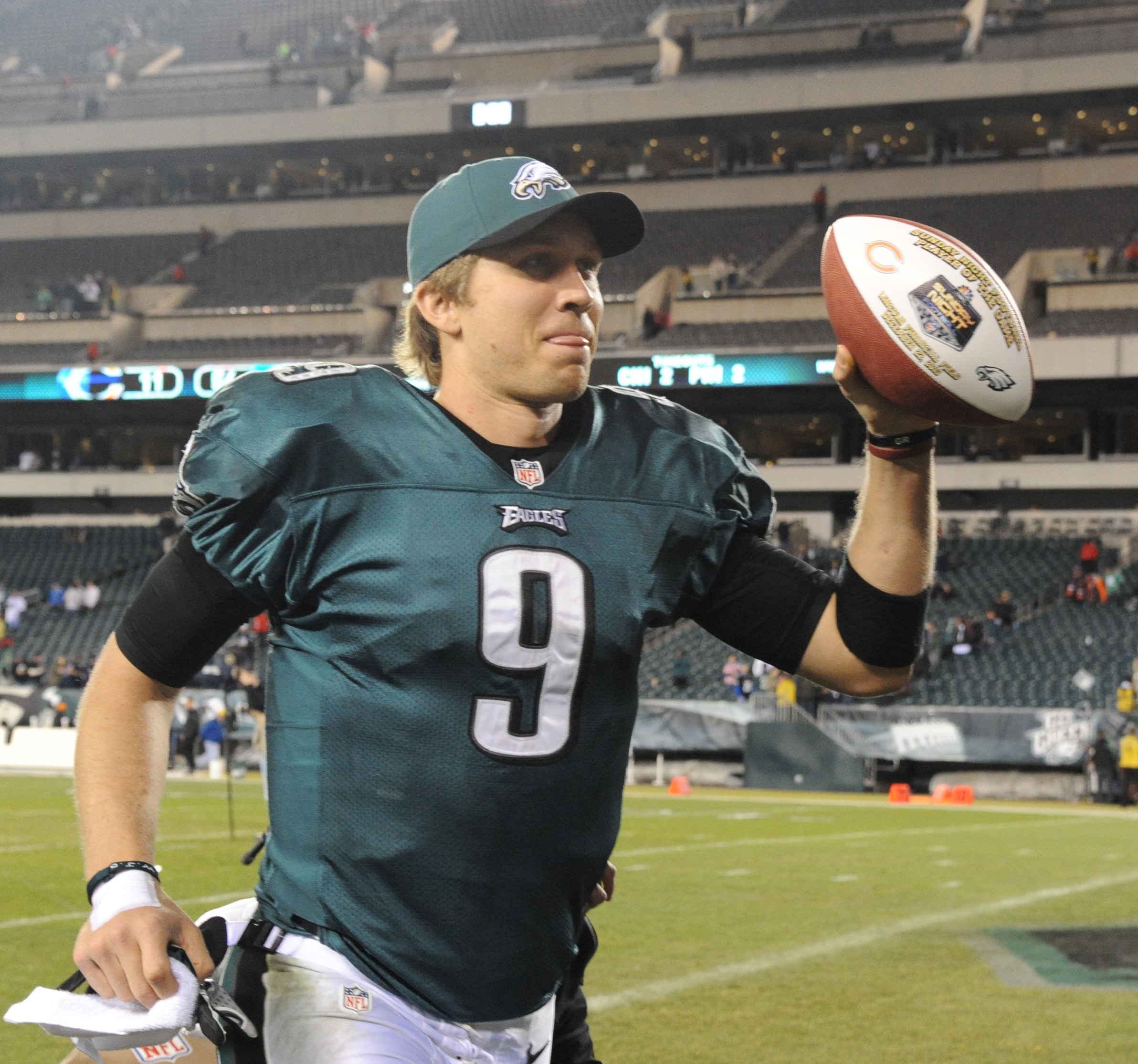 Eagles quarterback Nick Foles runs off the field holding a ball aloft after the Eagle beat the Chicago Bears 54-11 at Lincoln Financial Field Dec. 22, 2013. (CLEM MURRAY / Staff Photographer )