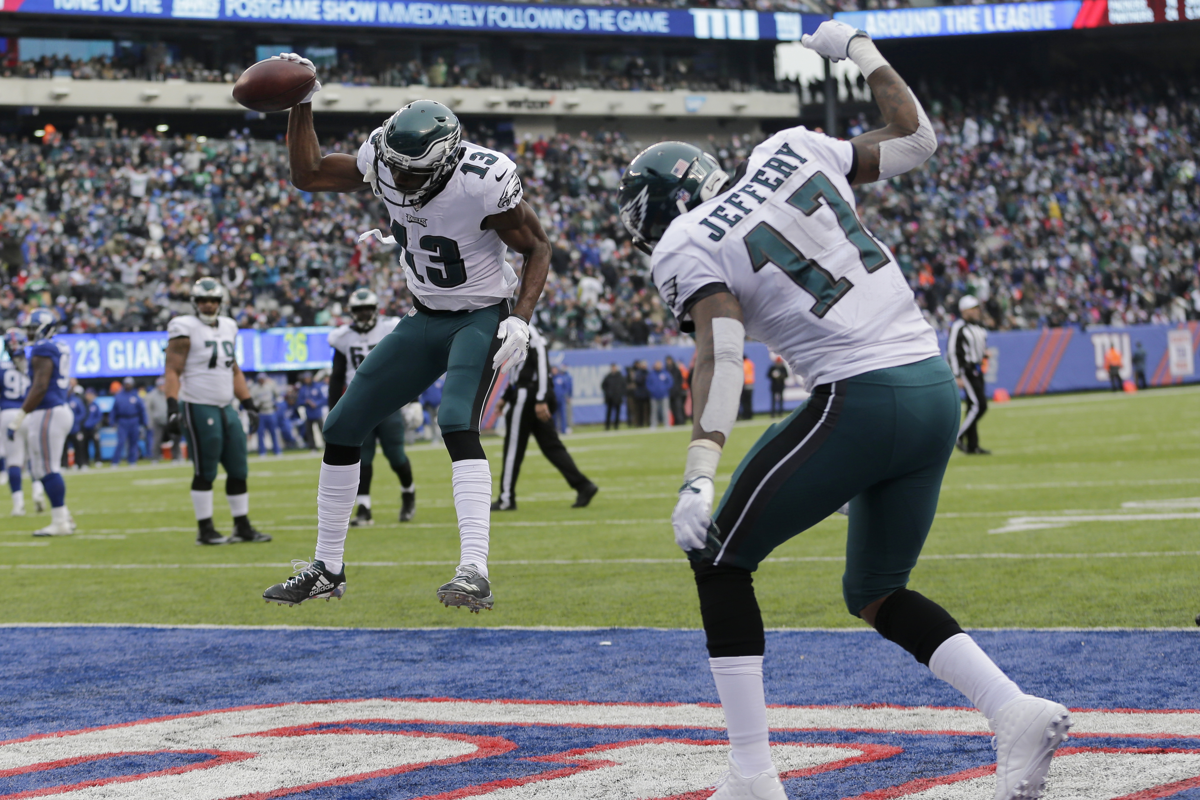 Eagles wide receiver Nelson Agholor (13) and wide receiver Alshon Jeffery (17) celebrate after Agholor caught a touchdown pass during the Eagles´ 34-29 win over the Giants on Sunday.