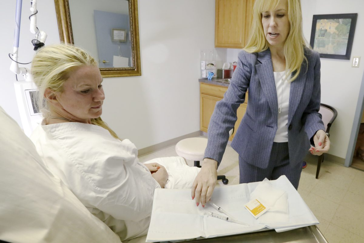 Trisha Smick of Medford (left) has a follow up visit with Dr. Beverly Mikes