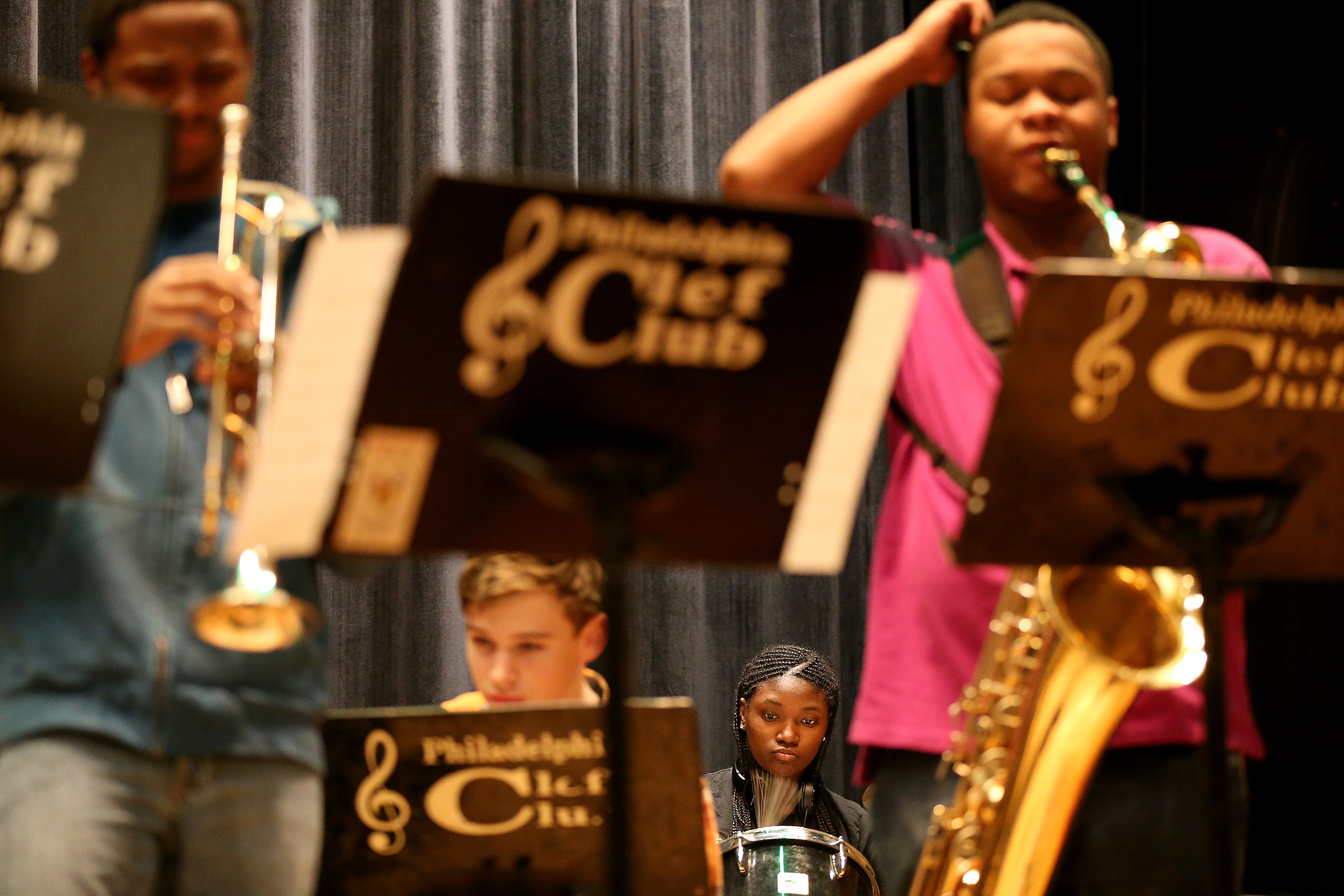 Kyah McCall, 16, background, plays the drums as members of the Clef Club Student Ensemble rehearse at the Clef Club. The ensemble will be part of the Watch Night for Social Justice concert. (DAVID MAIALETTI / Staff Photographer)