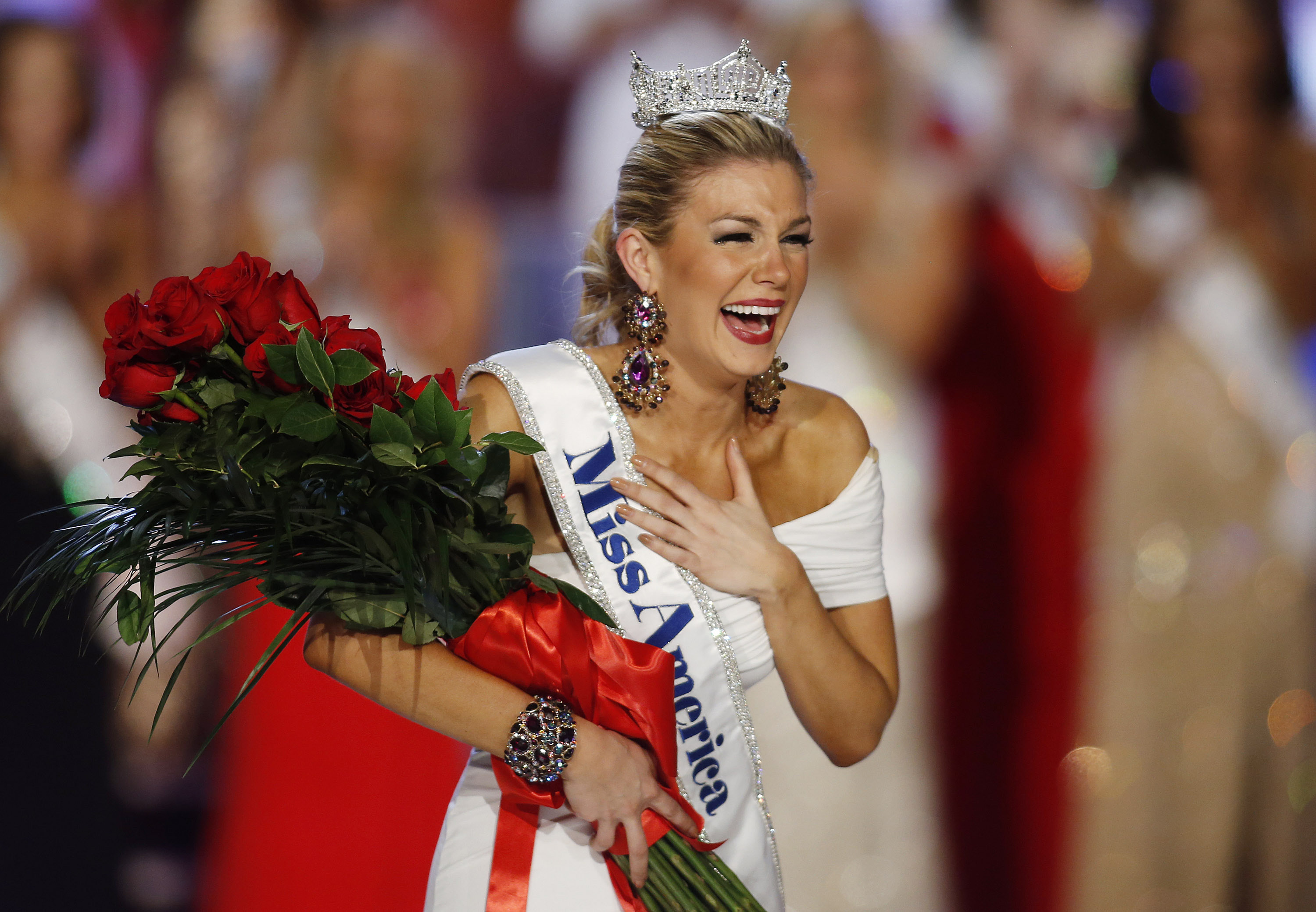 In this Jan. 12, 2013 file photo, Miss New York Mallory Hytes Hagan reacts as she is crowned Miss America 2013 in Las Vegas. Hagan was among former Miss Americas ridiculed in emails involving MAO CEO Sam Haskell, who stepped down on Saturday amid the latest scandal to rock the pageant.