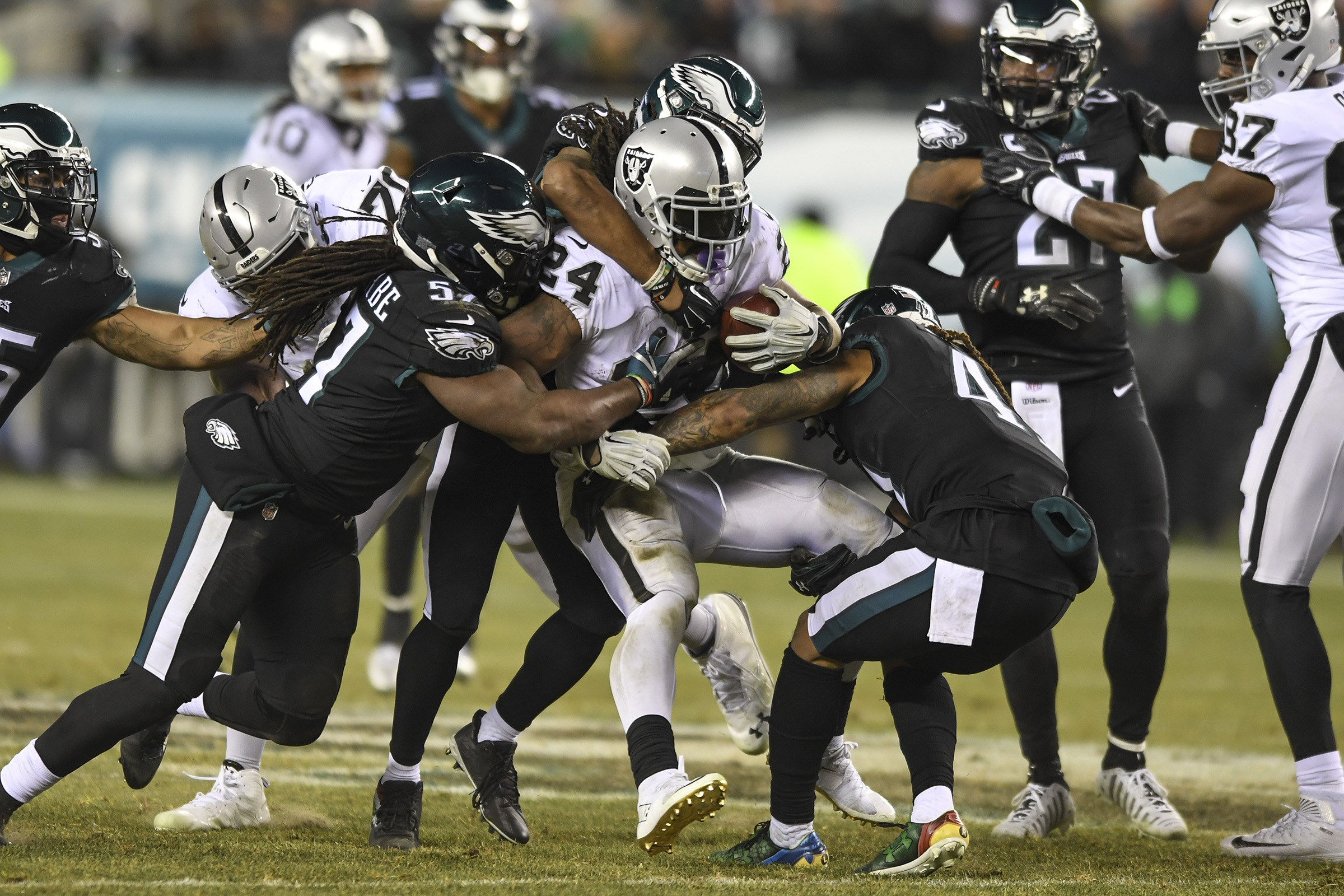 Raiders running back Marshawn Lynch is gang-tackled by Eagles Dannell Ellerbe (left), Rodney McLeod (center) and cornerback Ronald Darby in the second quarter.