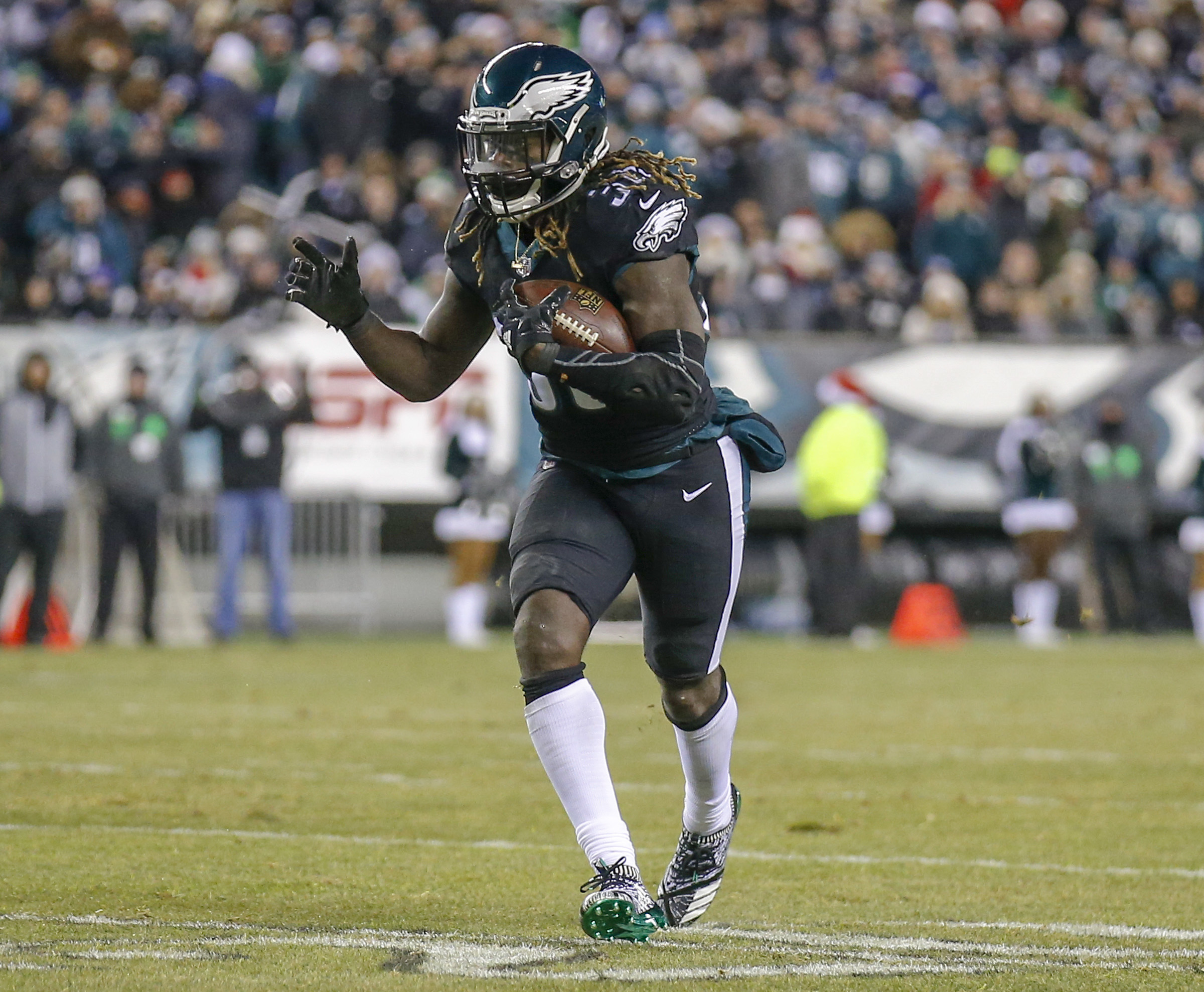 Eagles running back Jay Ajayi runs with the football against the Oakland Raiders on Monday, December 25, 2017 in Philadelphia. YONG KIM / Staff Photographer
