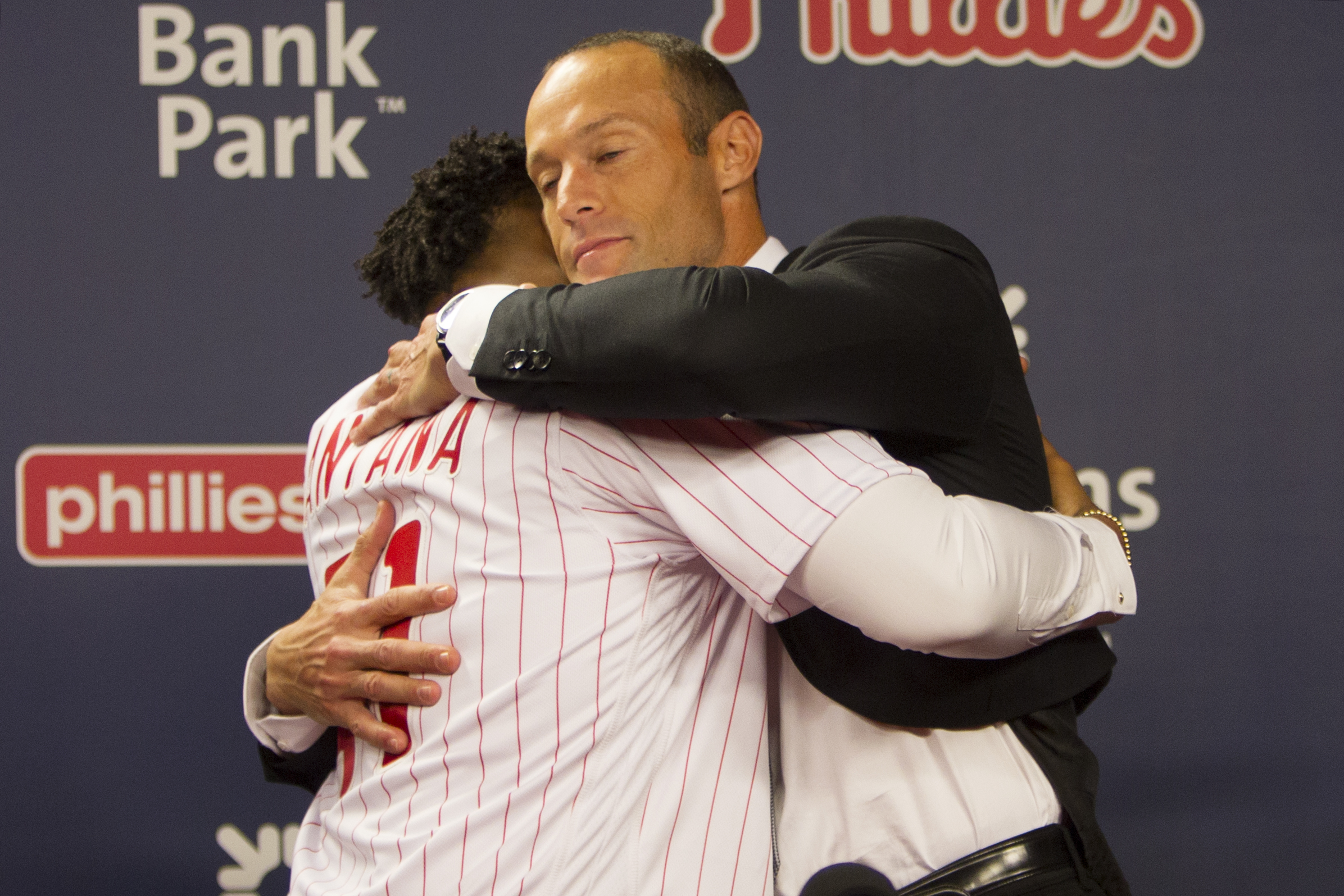 Phillies manager Gabe Kapler, right, hugging newly signed first baseman Carlos Santana last month.