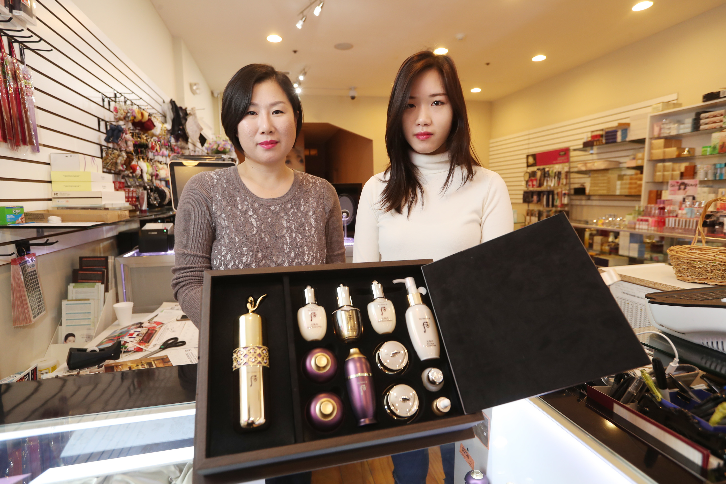 Jeanne Lee (L) and Linda Xu (R) show off the Whoo purple line at $1,100 cream at Ga-In BeautyZone in Chinatown.