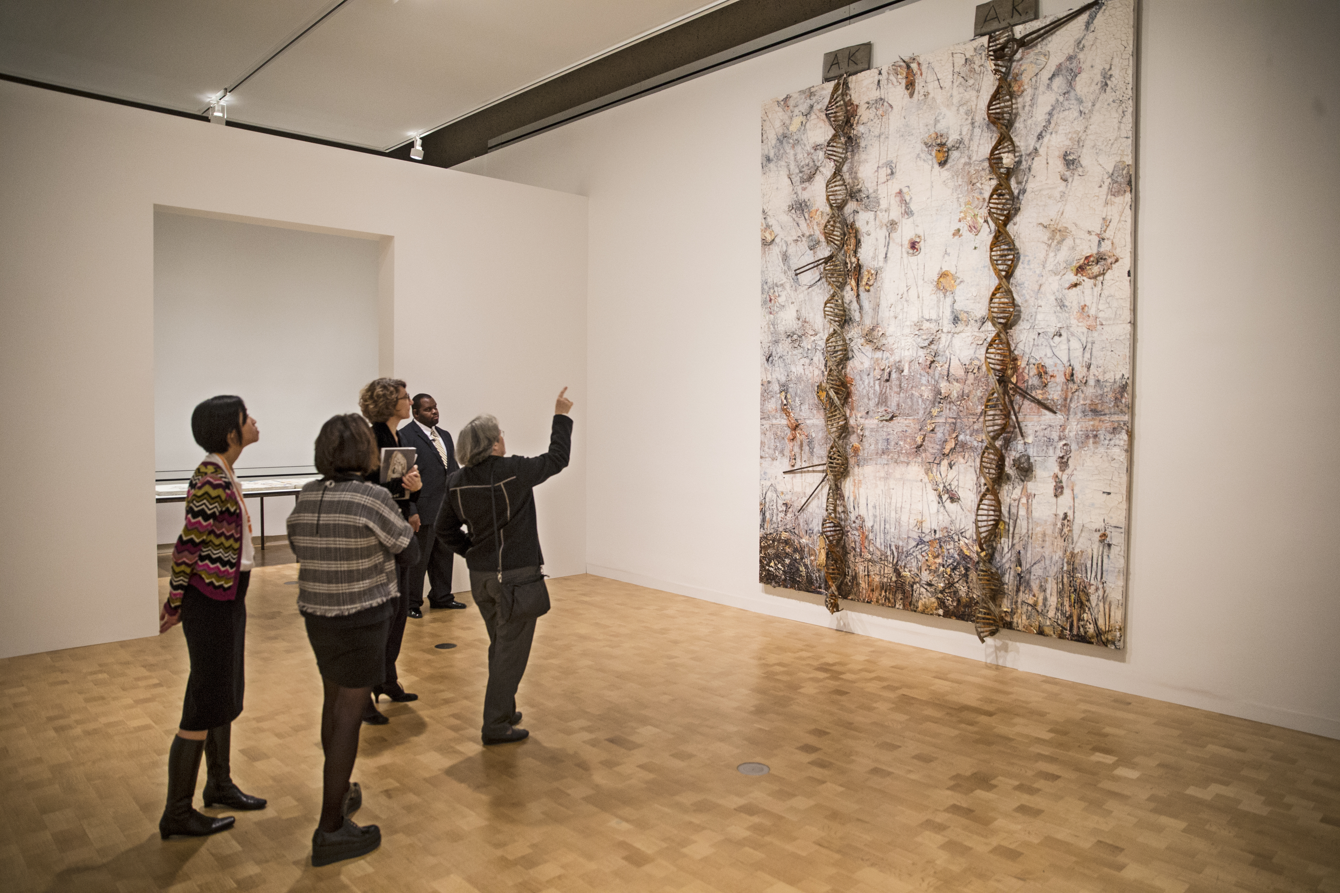 Visitors to the Barnes Foudation opening of the Kiefer Rodin Exhibition on Thursday November 16, 2017, discuss the painting A.R. A.K , 2017, oil, acrylic, clay, metal, plaster, lead and zinc on canvas, painted by Anselm Kiefer. German painter Anselm Kiefer, widely seen as one of the most significant artists in the world, has produced work inspired by Rodin. The Barnes Foundation hosts the fruit of this artistic encounter, Kiefer-Rodin, in its special exhibition opening Friday. The artist, known for his monumental canvas explorations of the tragedies of German history.
