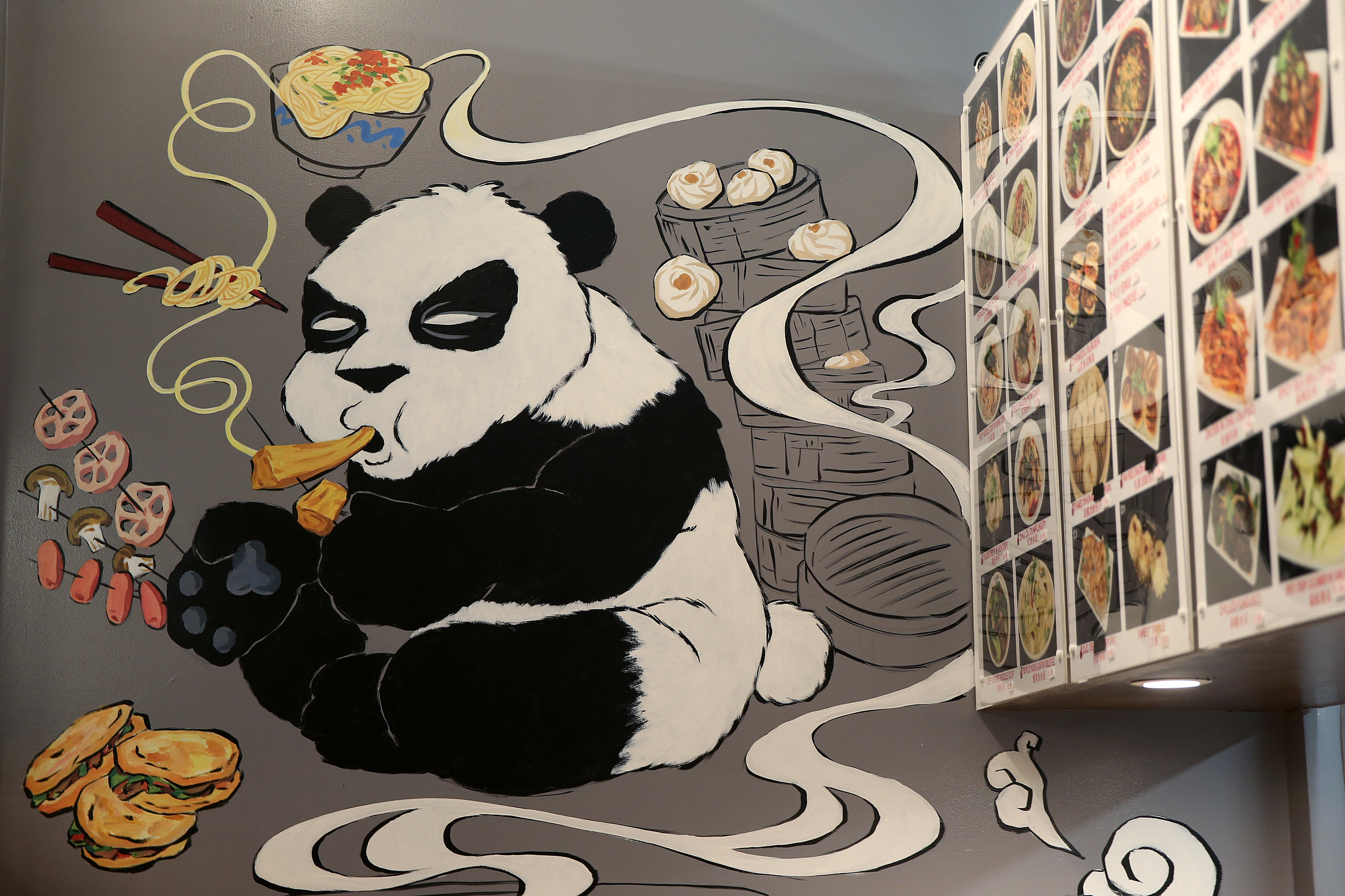 A panda mural presides over the casual dining room at Chengdu Famous Food.